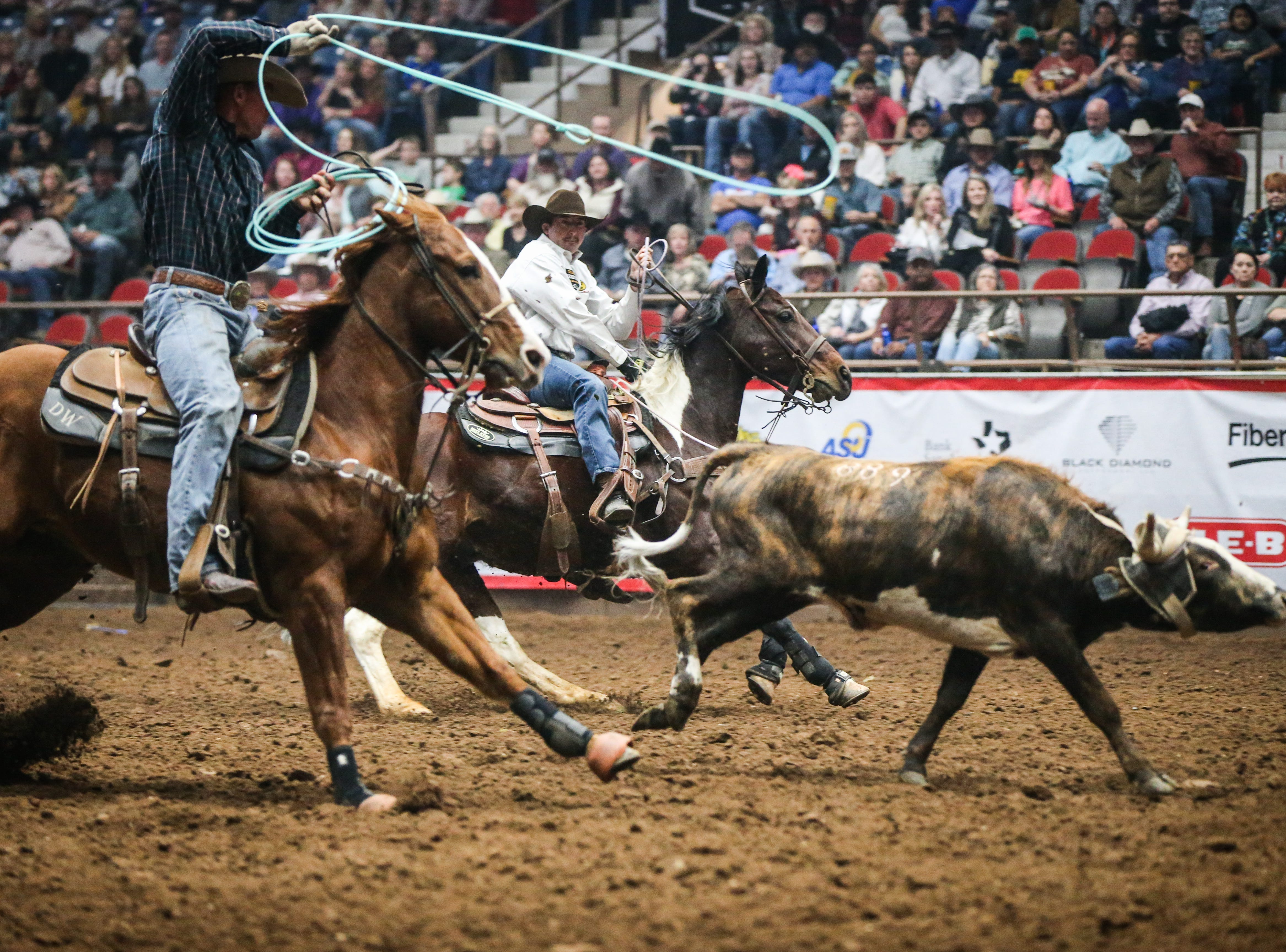 Lane Santos Karney, back, and Dillon Wingereid team rope during finals of the San Angelo Stock Show & Rodeo Friday, Feb. 15, 2019, at Foster Communications Coliseum.