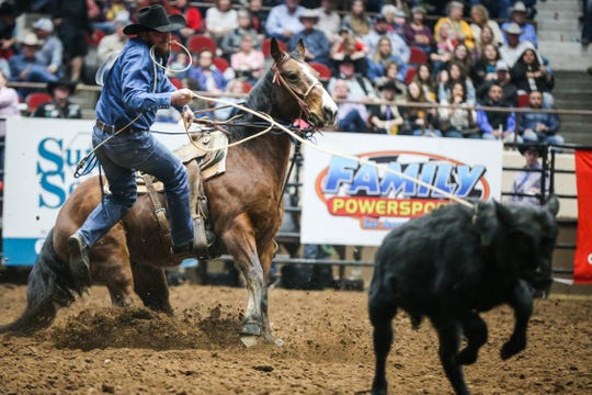 Blake Ash catches a calf in tie down roping during finals of the San Angelo Stock Show & Rodeo Friday, Feb. 15, 2019, at Foster Communications Coliseum.