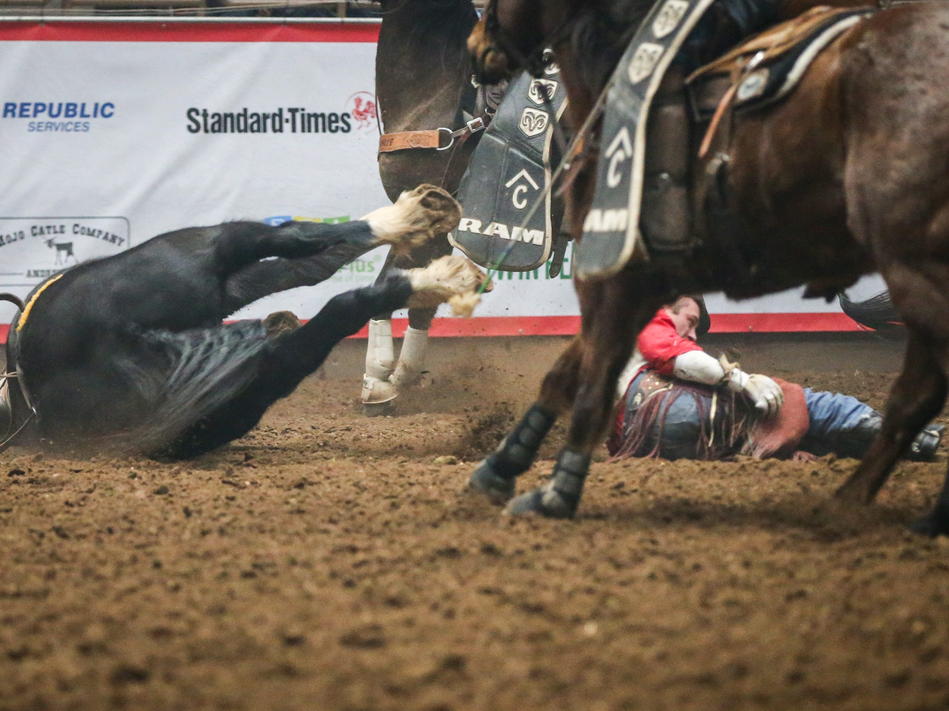 Nate McFadden and the horse Black Out fall during McFadden's bareback ride during finals of the San Angelo Stock Show & Rodeo Friday, Feb. 15, 2019, at Foster Communications Coliseum.
