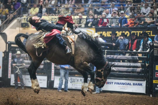 Caleb Bennett rides bareback on Spilled Perfume during finals of the San Angelo Stock Show & Rodeo Friday, Feb. 15, 2019, at Foster Communications Coliseum.