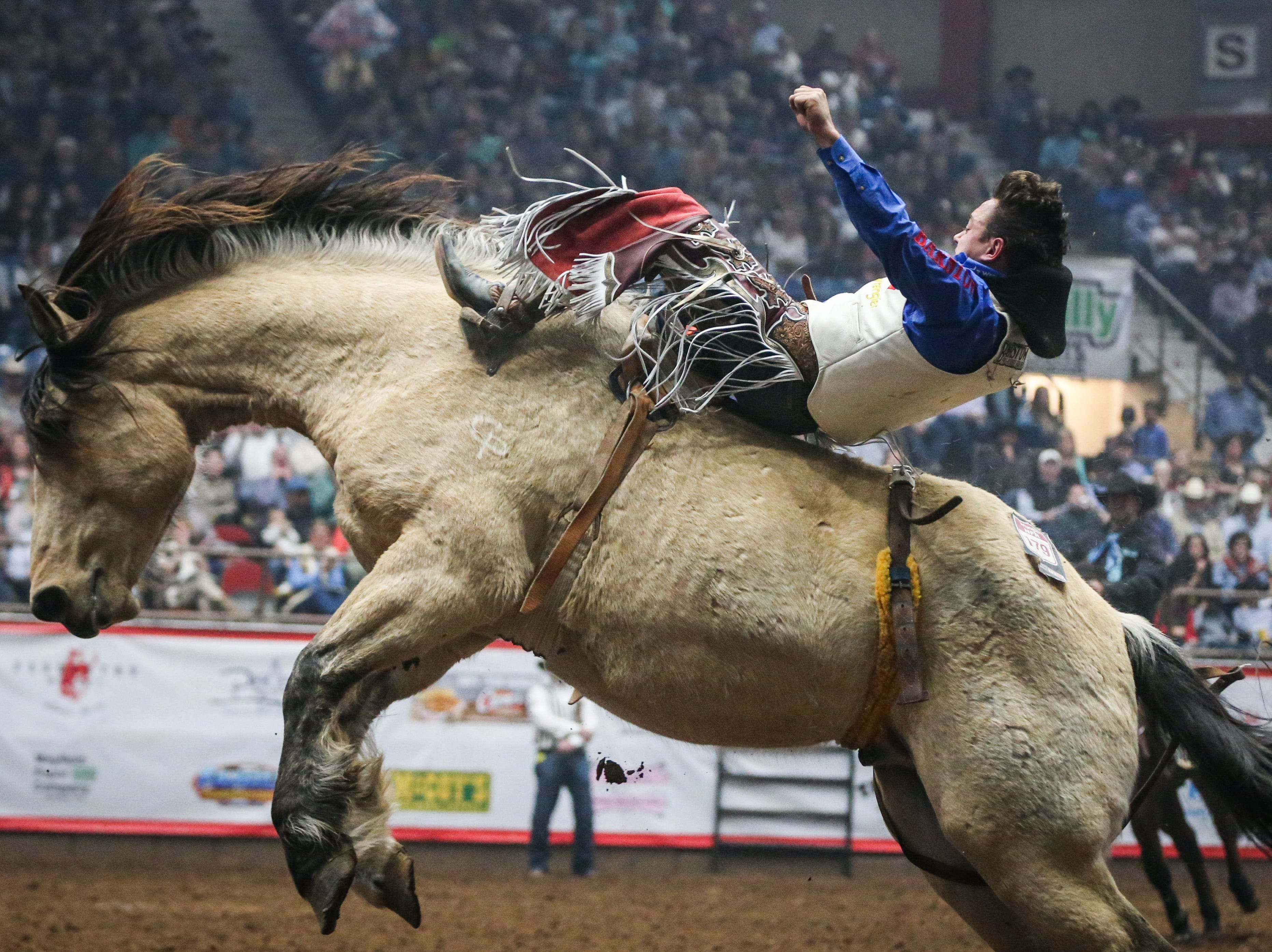 Clayton Biglow rides bareback on Uncapped during finals of the San Angelo Stock Show & Rodeo Friday, Feb. 15, 2019, at Foster Communications Coliseum.