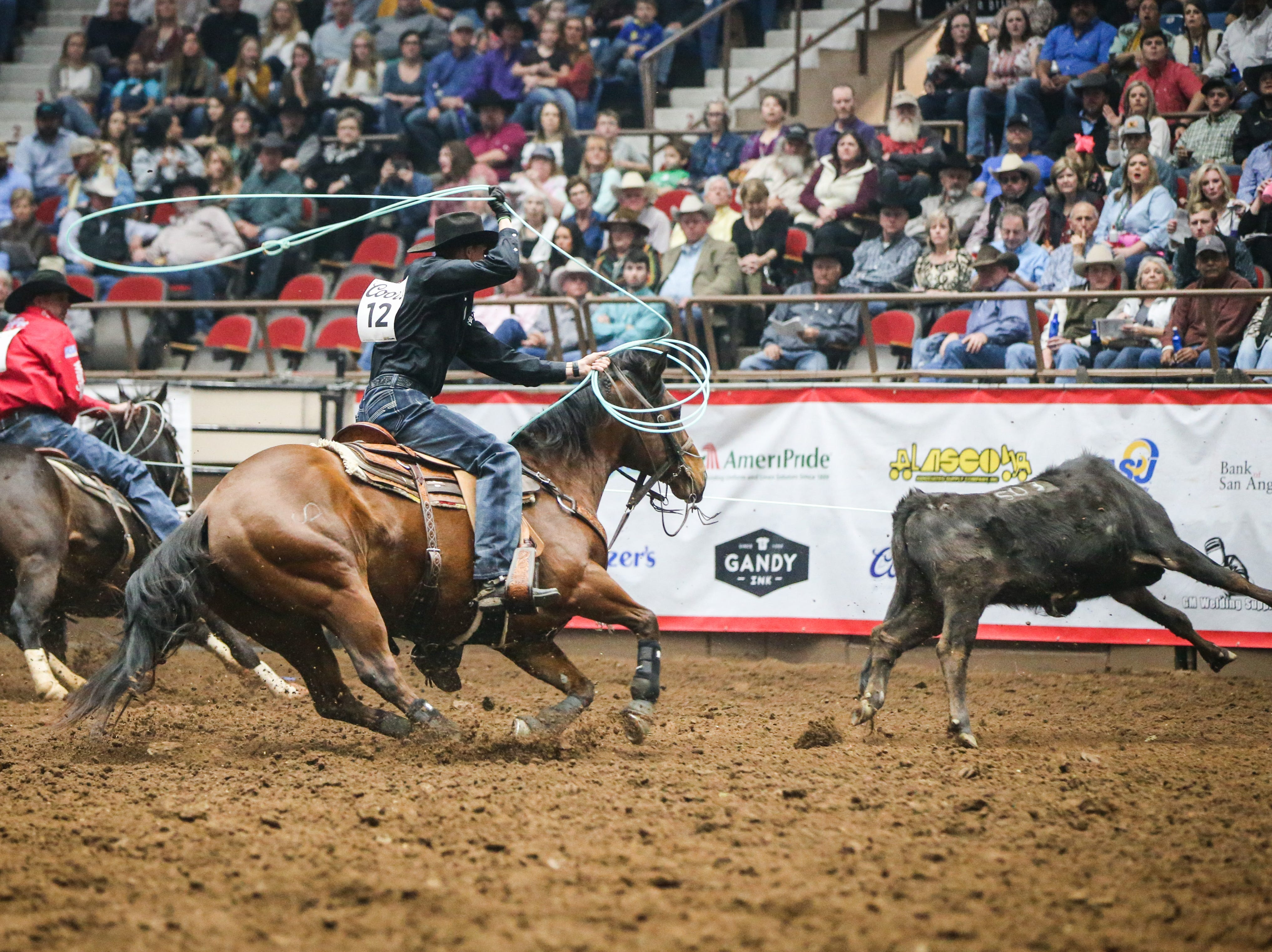 Manny Egusquiza Jr, back, and Dustin Searcy team rope during finals of the San Angelo Stock Show & Rodeo Friday, Feb. 15, 2019, at Foster Communications Coliseum.