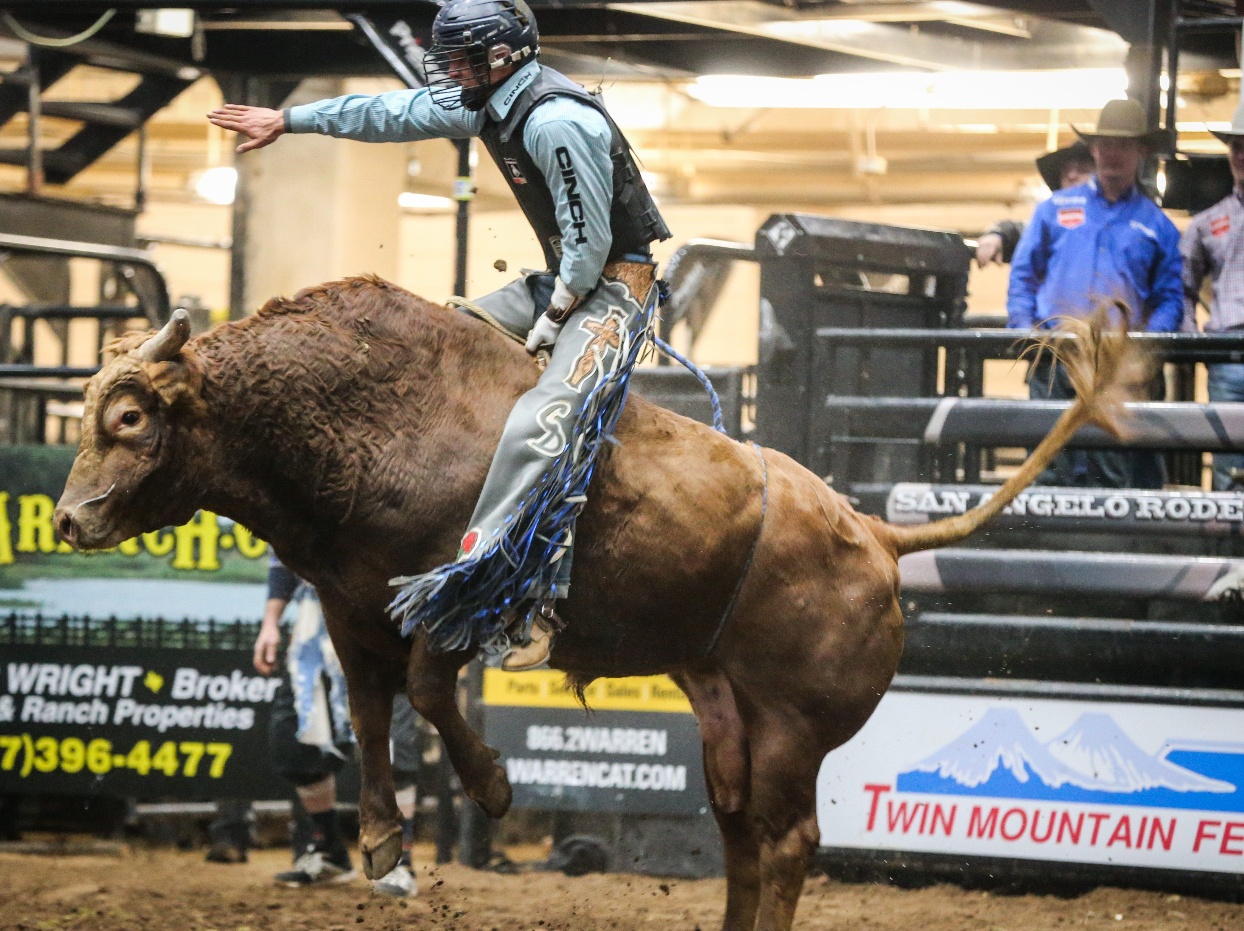 Chase Dougherty rides a bull during finals of the San Angelo Stock Show & Rodeo Friday, Feb. 15, 2019, at Foster Communications Coliseum.
