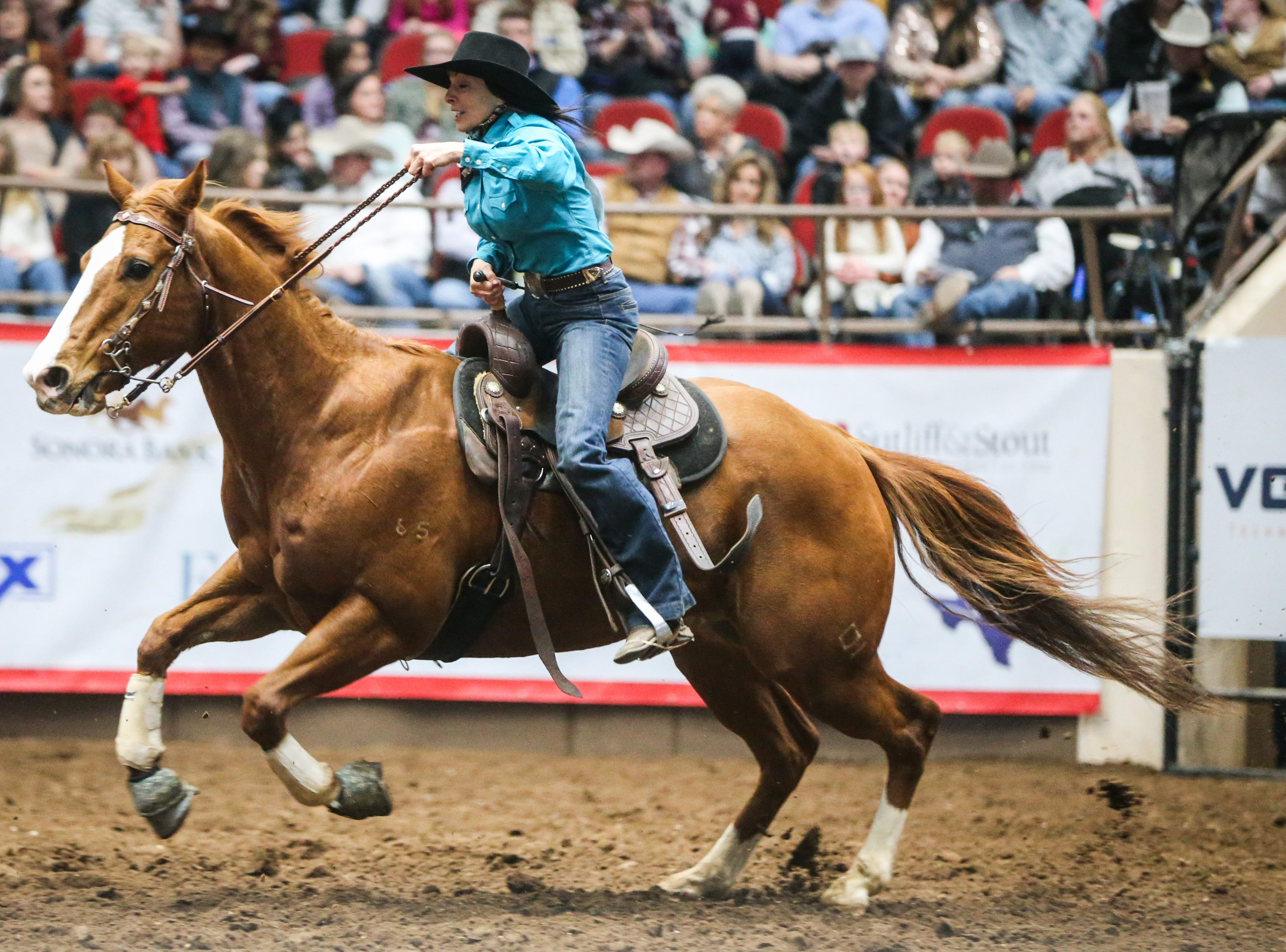 Teri Bangart races the barrels during finals of the San Angelo Stock Show & Rodeo Friday, Feb. 15, 2019, at Foster Communications Coliseum.