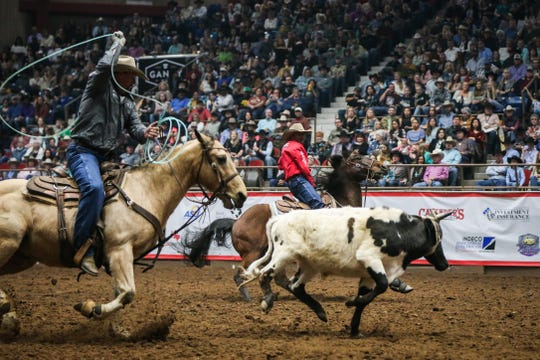 Aaron Tsinigine and Kyle Lockett team rope during finals of the San Angelo Stock Show & Rodeo Friday, Feb. 15, 2019, at Foster Communications Coliseum.