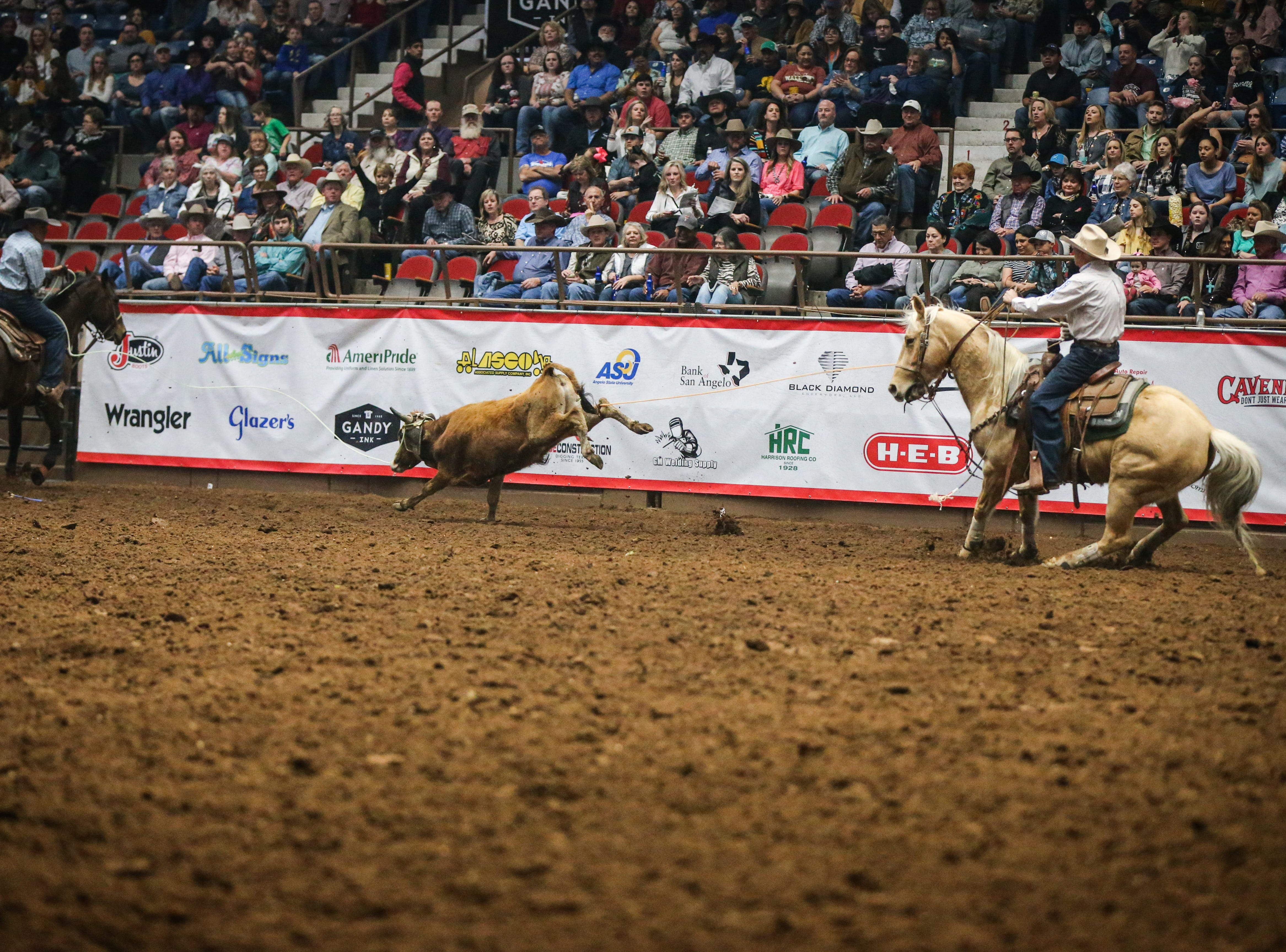 Ryan Reed and Monty Joe Petska, right, team rope during finals of the San Angelo Stock Show & Rodeo Friday, Feb. 15, 2019, at Foster Communications Coliseum.