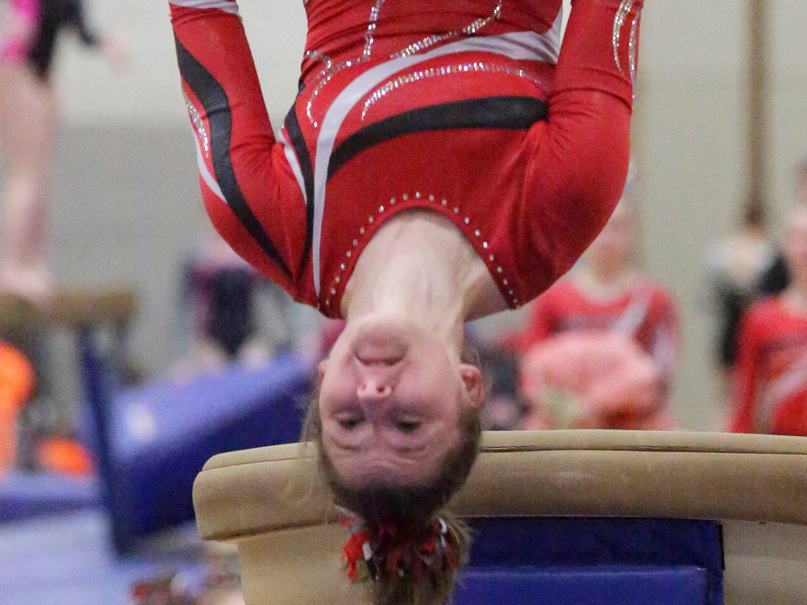 Manitowoc Lincoln's Brynn Tackett is upside down during her vault attempt at the WIAA Eastern Valley Conference Gymnastics Meet at Sheboygan South, Friday, February 15, 2019, in Sheboygan, Wis.