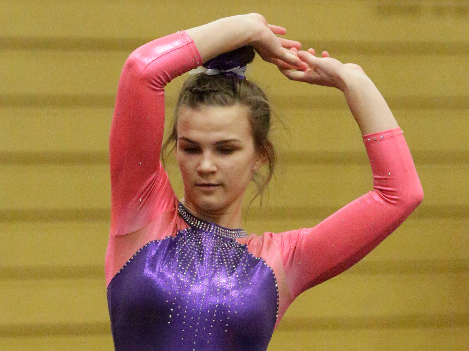 Oshkosh's Megan Best moves during her floor exercise at the WIAA Eastern Valley Conference Gymnastics Meet at Sheboygan South, Friday, February 15, 2019, in Sheboygan, Wis.