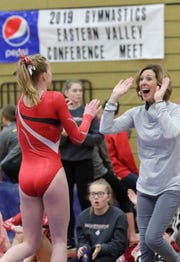 Manitowoc Lincoln coach Jacque Bartow is all smiles following a balance beam routine by an unidentified gymnast during the Eastern Valley Conference gymnastics meet at Sheboygan South Friday.