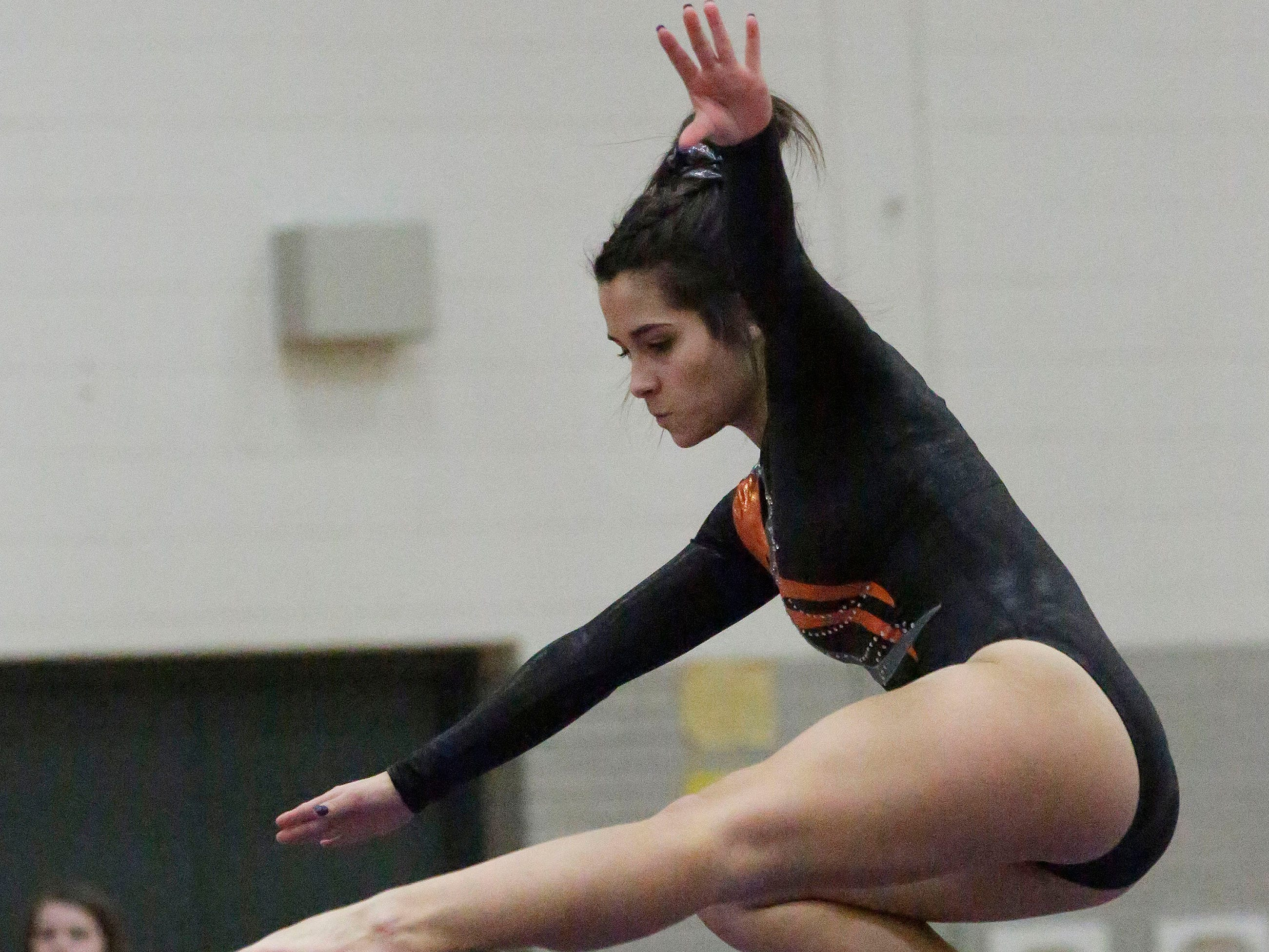 Kaukauna's Grace Moore works the balance beam during the WIAA Eastern Valley Conference Gymnastics Meet at Sheboygan South, Friday, February 15, 2019, in Sheboygan, Wis.
