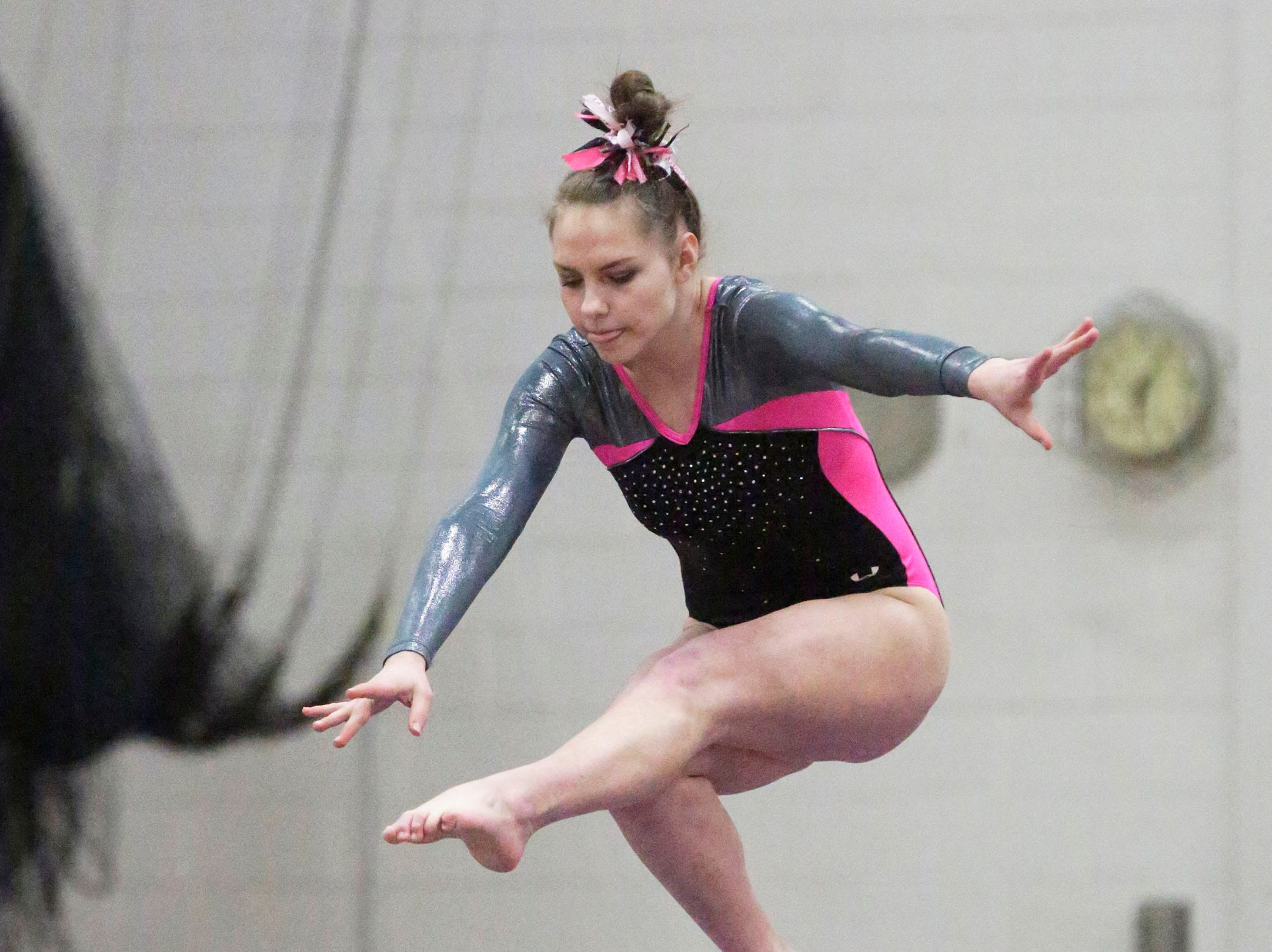 Sheboygan North/South's Maddie Lewis is airborne on the beam during the WIAA Eastern Valley Conference Gymnastics Meet at Sheboygan South, Friday, February 15, 2019, in Sheboygan, Wis.