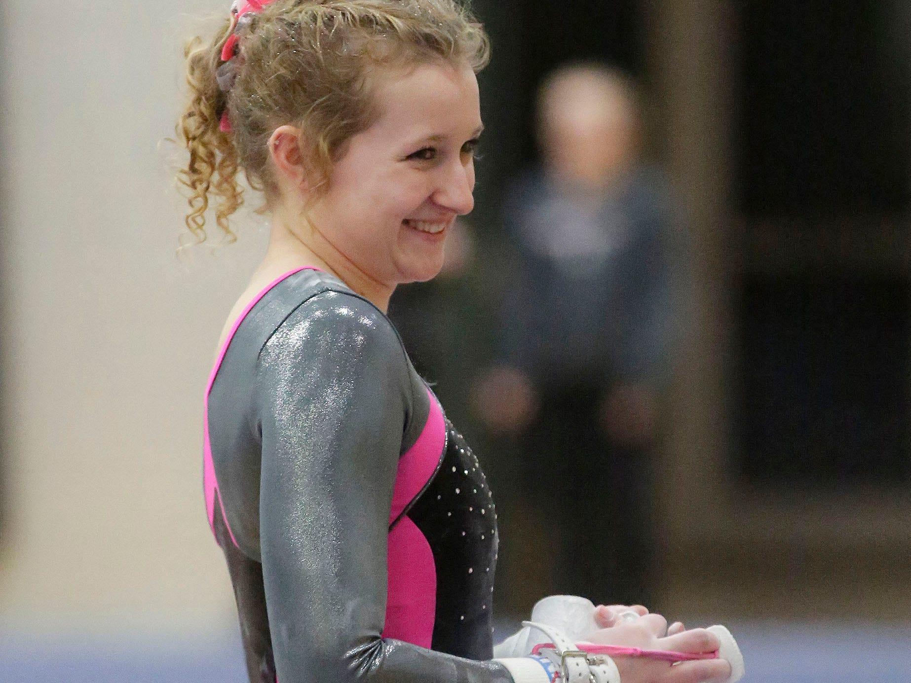 Sheboygan North/South's Annika Glaven smiles during the WIAA Eastern Valley Conference Gymnastics Meet at Sheboygan South, Friday, February 15, 2019, in Sheboygan, Wis.