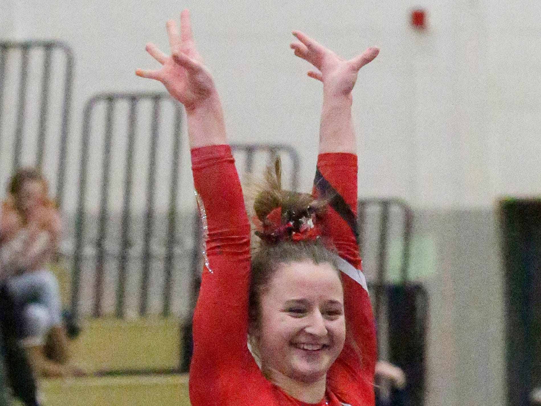 Manitowoc Lincoln's Brynn Tackett is all smiles following her balance beam routine at the WIAA Eastern Valley Conference Gymnastics Meet at Sheboygan South, Friday, February 15, 2019, in Sheboygan, Wis.