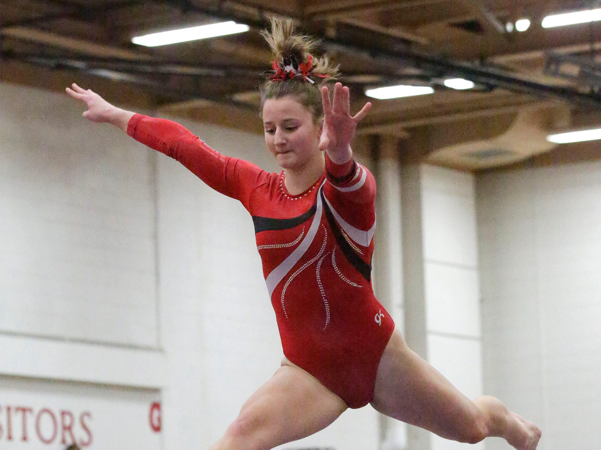 Manitowoc Lincoln's Brynn Tackett is airborne on the balance beam during the WIAA Eastern Valley Conference Gymnastics Meet at Sheboygan South, Friday, February 15, 2019, in Sheboygan, Wis.
