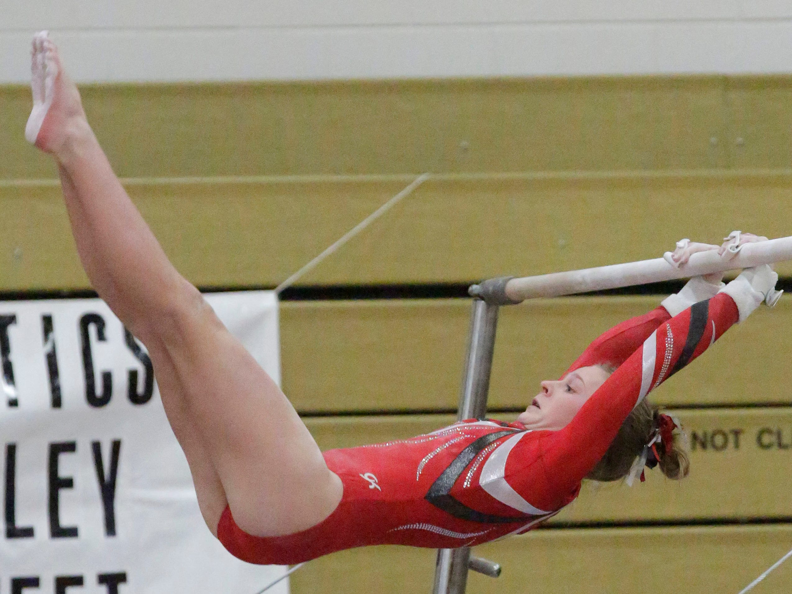 Manitowoc Lincoln's Caroline Ramminger works her bars routine at the WIAA Eastern Valley Conference Gymnastics Meet at Sheboygan South, Friday, February 15, 2019, in Sheboygan, Wis.