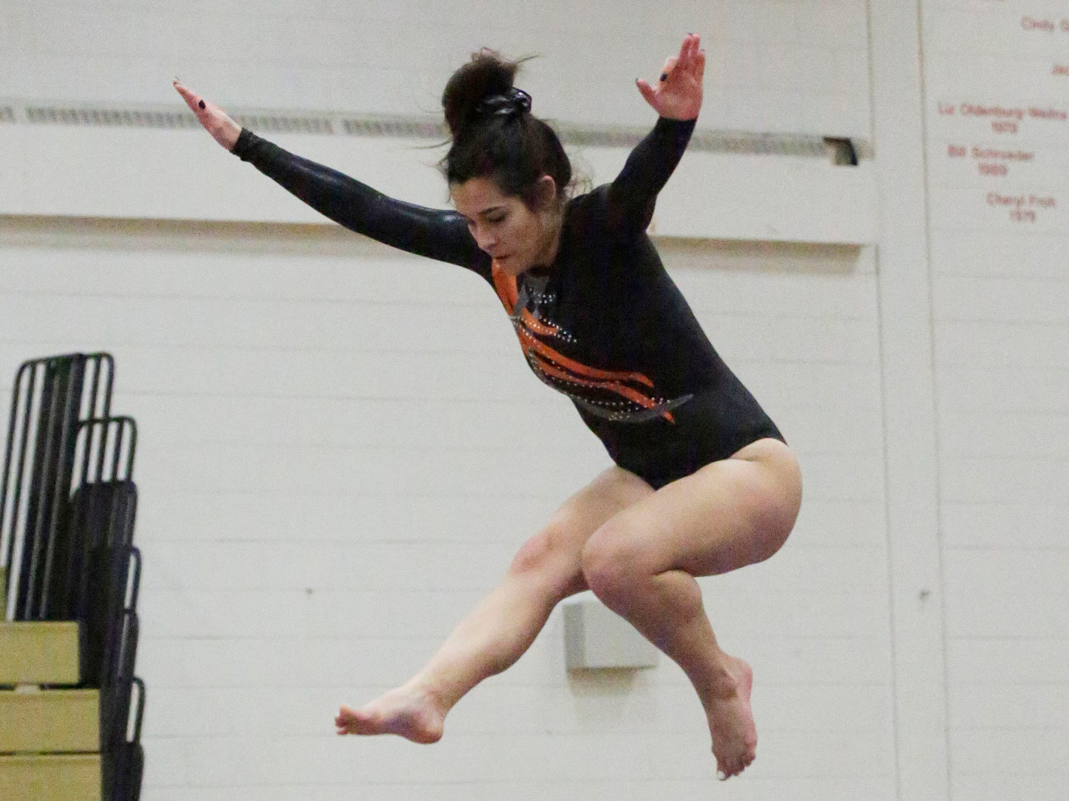 Kaukauna's Grace Moore leaps on the balance beam during the WIAA Eastern Valley Conference Gymnastics Meet at Sheboygan South, Friday, February 15, 2019, in Sheboygan, Wis.
