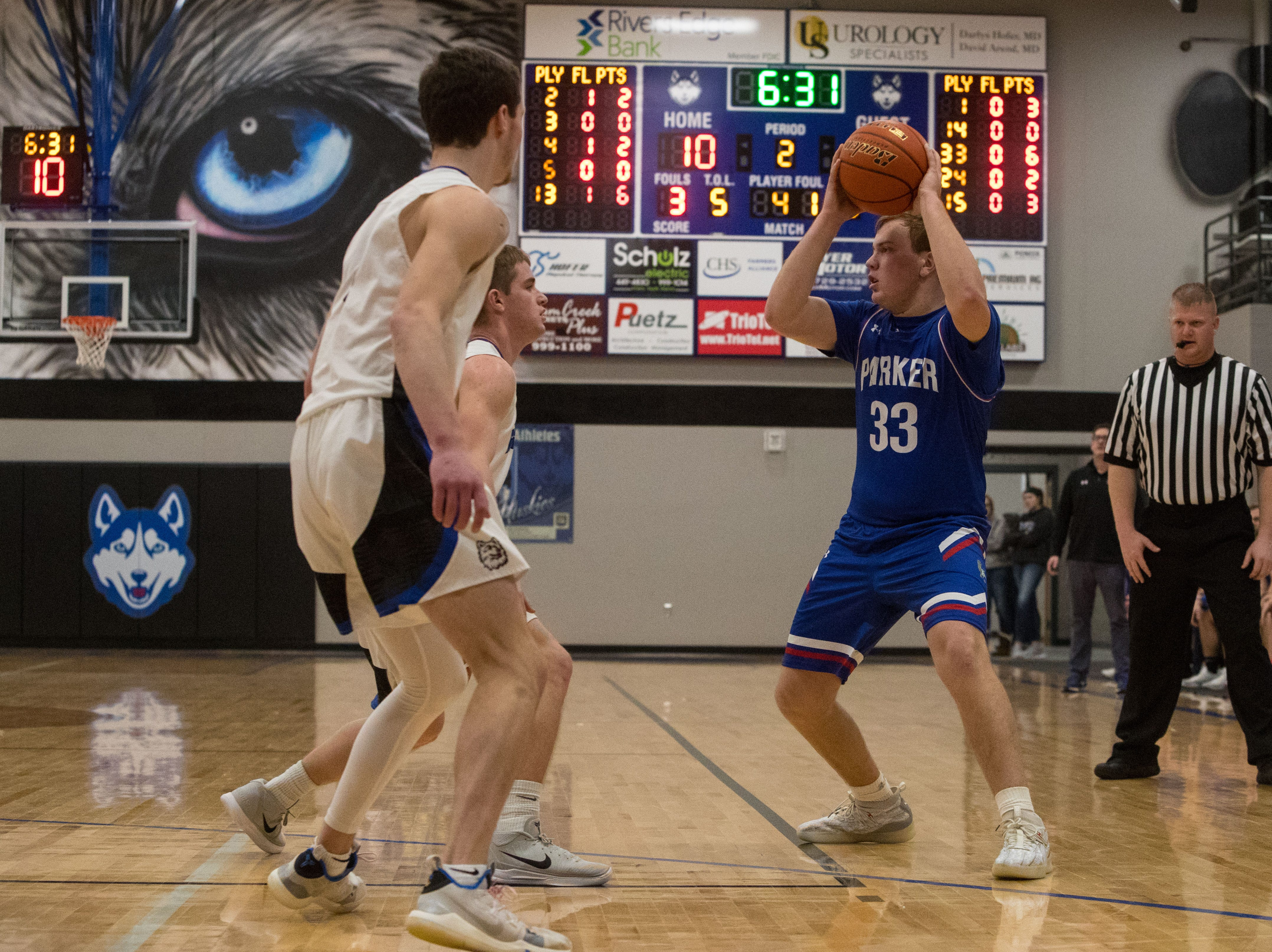 Parker's Jackson Fiegen (33) looks to pass the ball during a game against Bridgewater Emery, Friday, Feb. 15, 2019 in Emery, S.D.