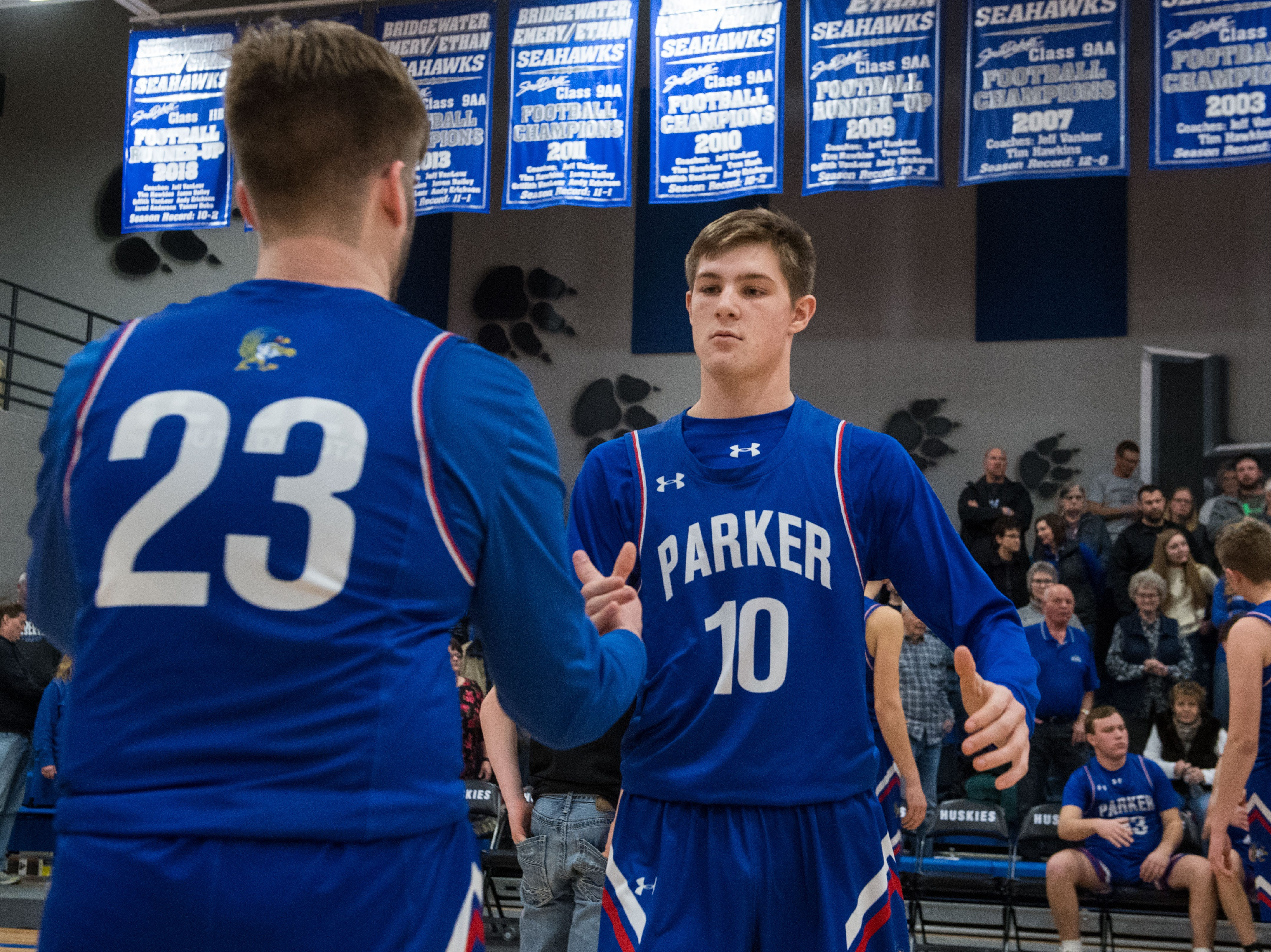 Parker's Reece Peters (10) shakes hands with Jace Bridges (23) before the game against Bridgewater Emery, Friday, Feb. 15, 2019 in Emery, S.D.