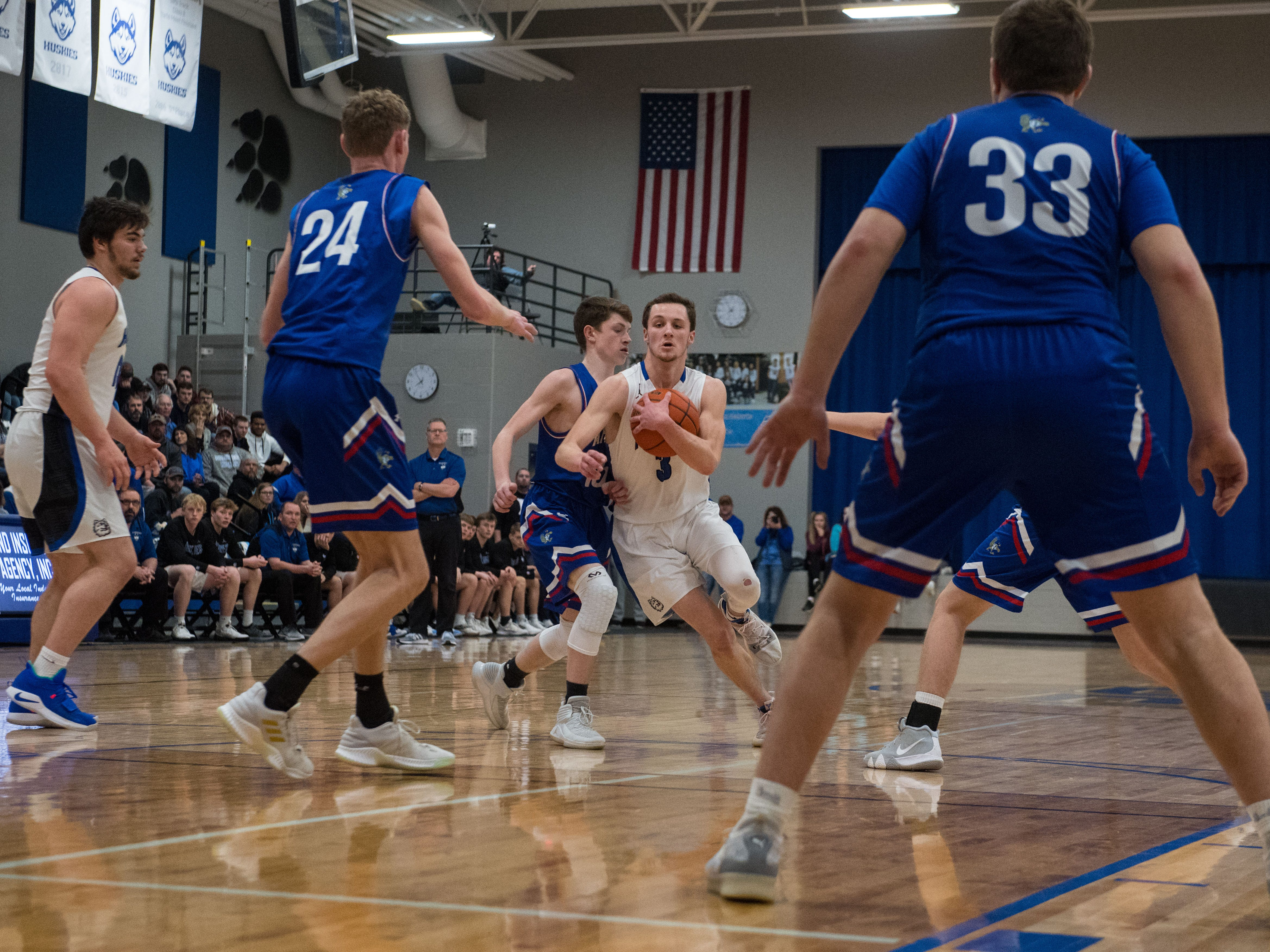 Bridgewater Emery's Sawyer Schultz (3) dribbles the ball past Parker players during a game in Emery, S.D., Friday, Feb. 15, 2019.