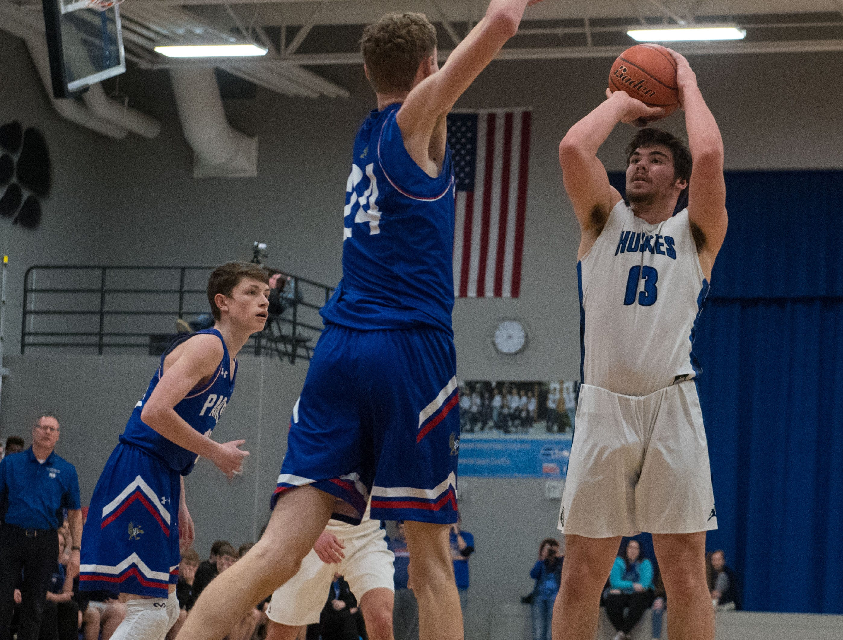 Bridgewater Emery's Carter Dye (13) shoots the ball over Parker player during a game in Emery, S.D., Friday, Feb. 15, 2019.