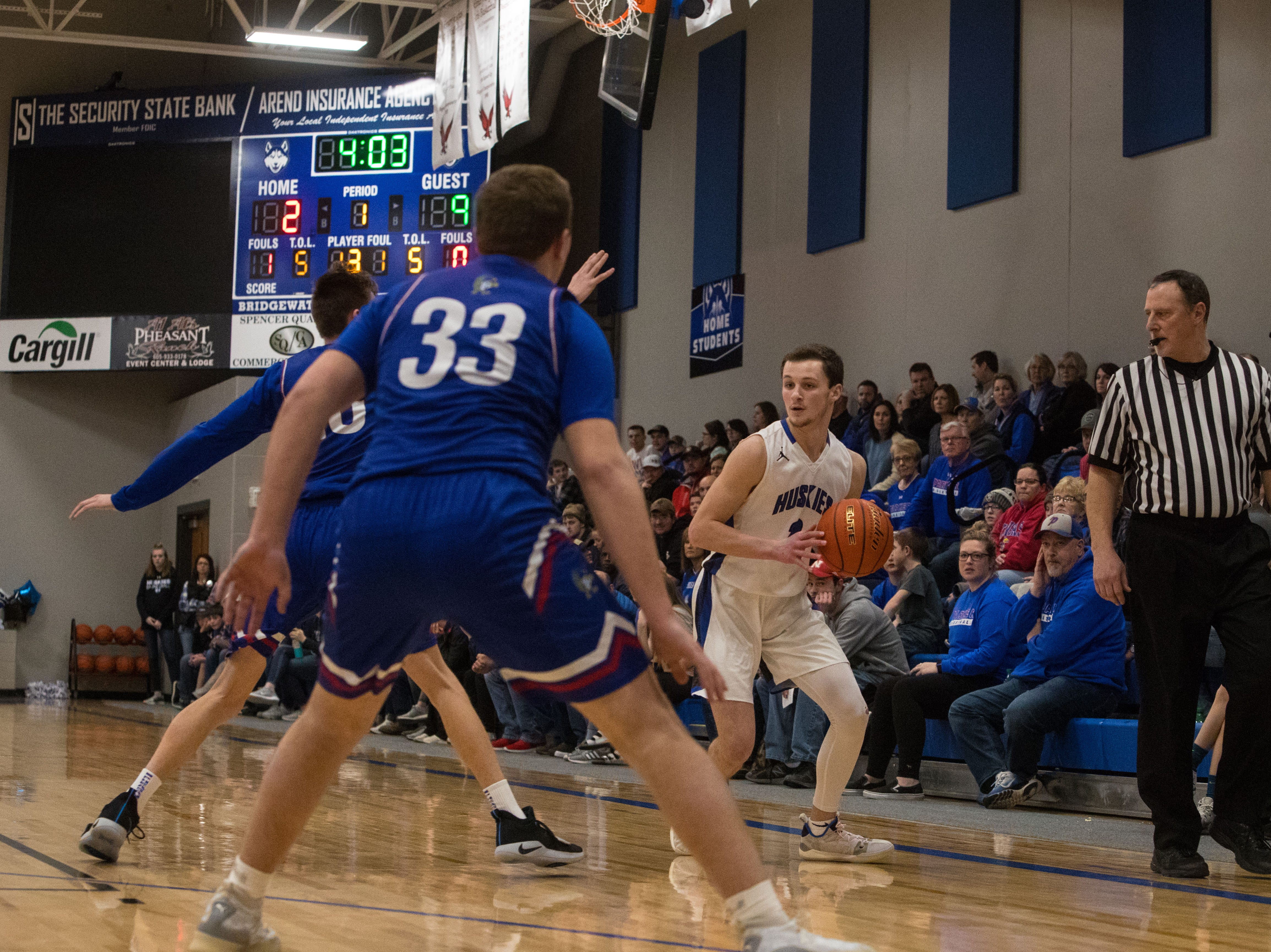 Bridgewater Emery's Sawyer Schultz (3) looks to pass the ball during a game against Parker, Friday, Feb. 15, 2019 in Emery, S.D.