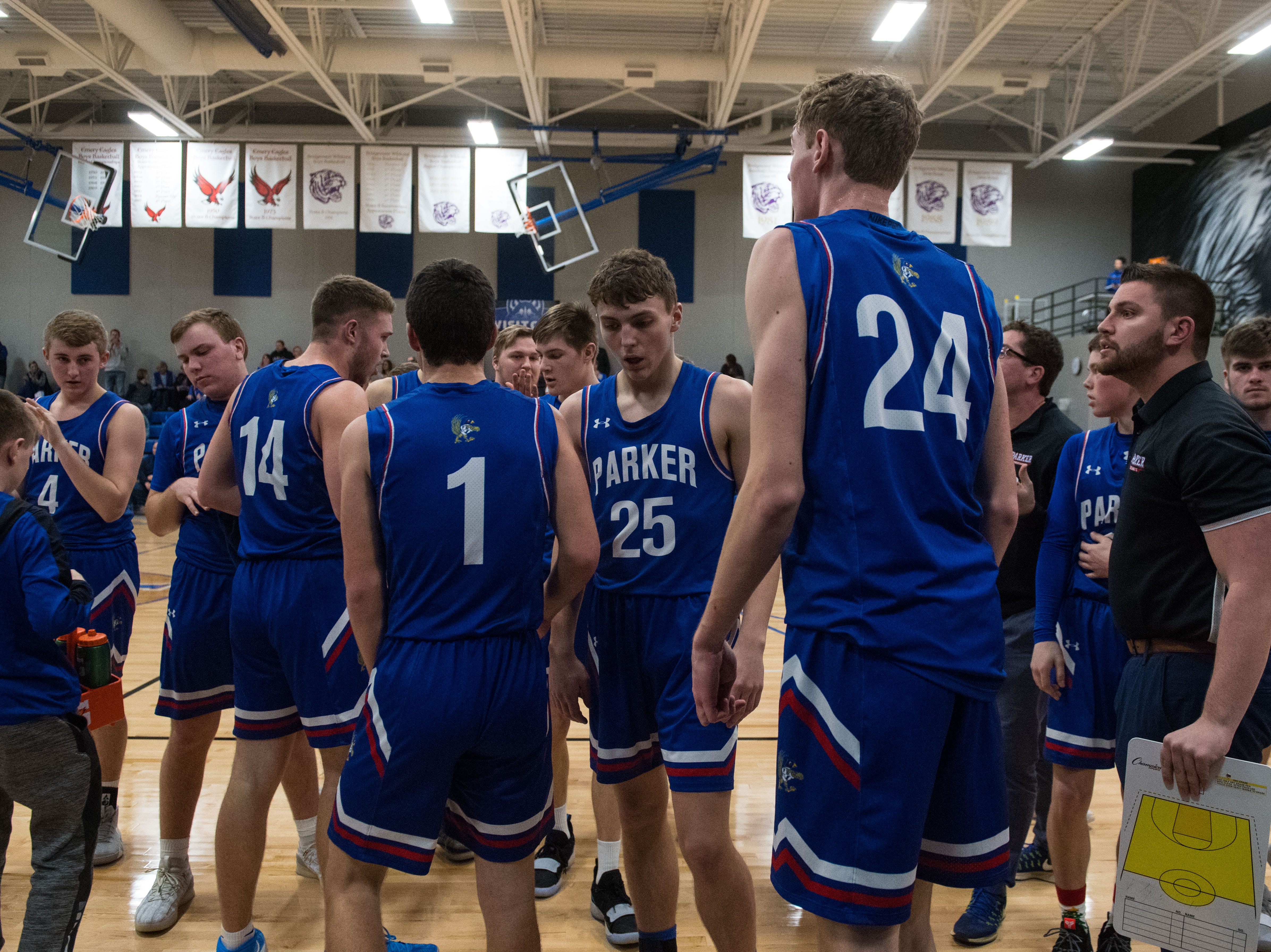 Parker team huddles during a game against Bridgewater Emery, Friday, Feb. 15, 2019 in Emery, S.D.