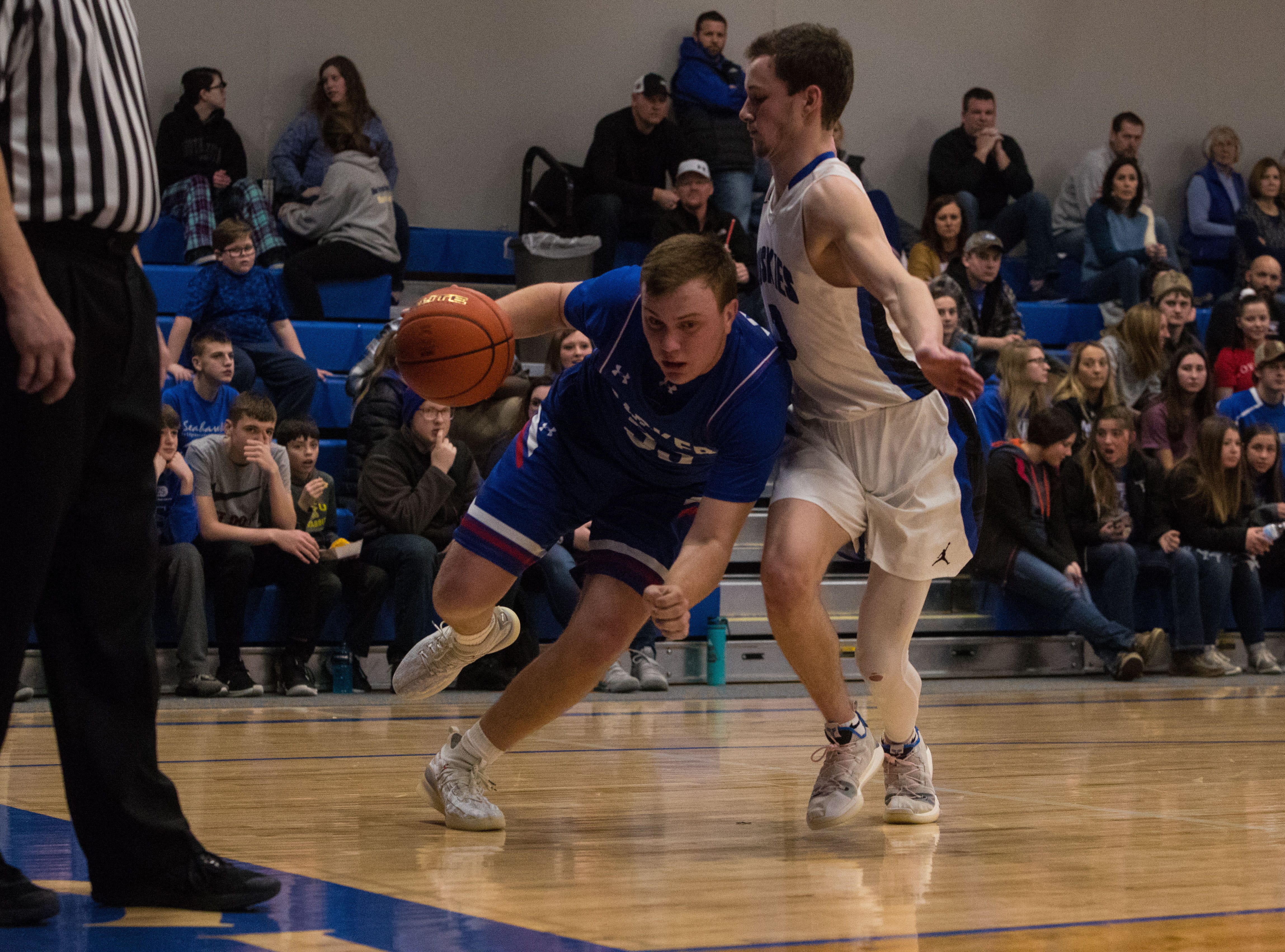 Parker's Jackson Fiegen (33) dribbles the ball around Bridgewater Emery's Sawyer Schultz (3) during a game in Emery, S.D., Friday, Feb. 15, 2019.