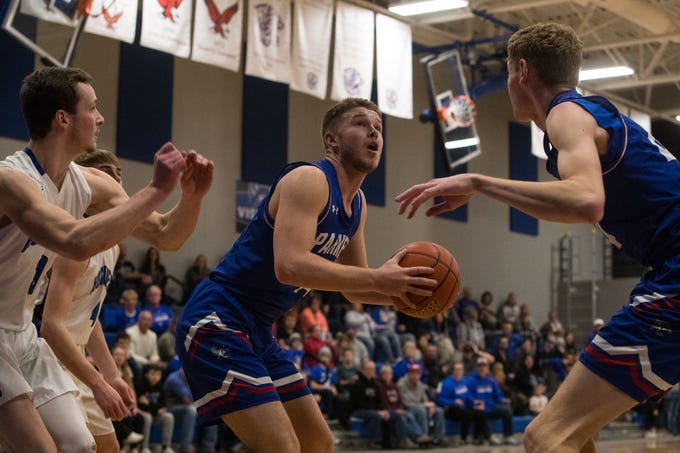 Parker's Jackson Fiegen (14) Trey Christensen (14) prepares to shoot the ball during a game against Bridgewater Emery, Friday, Feb. 15, 2019 in Emery, S.D.