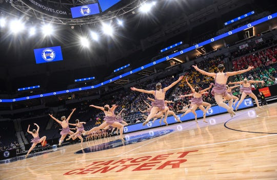 Sartell dance team members leap into the air during their performance Friday, Feb. 15, during the Minnesota Dance Team Jazz Tournament finals at the Target Center in Minneapolis.