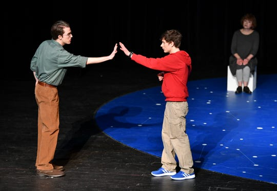 "Cast members perform a scene from an opening act of ""The Curious Incident of the Dog in the Night-Time"" Thursday, Feb. 14, at St. Cloud State University."