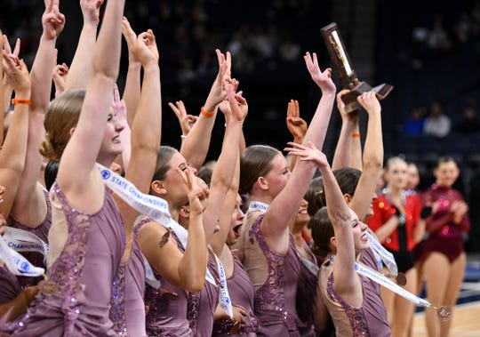 Sartell dancers hold their third place trophy Friday, Feb. 15, during the Minnesota Dance Team Jazz Tournament finals at the Target Center in Minneapolis.
