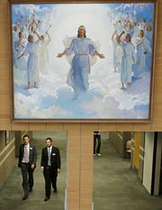 People walk through the halls at the Missionary Training Center in Provo in this file photo from 2013. LDS Church leadership announced a plan to increase the price of missions starting in July 2020.