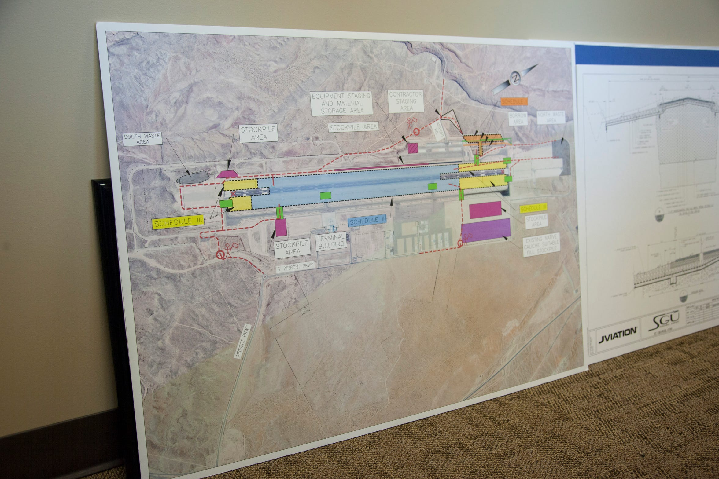 Officials at the St. George Airport discuss the runway problems created by a shifting foundation and the upcoming construction Friday, Feb. 15, 2019.