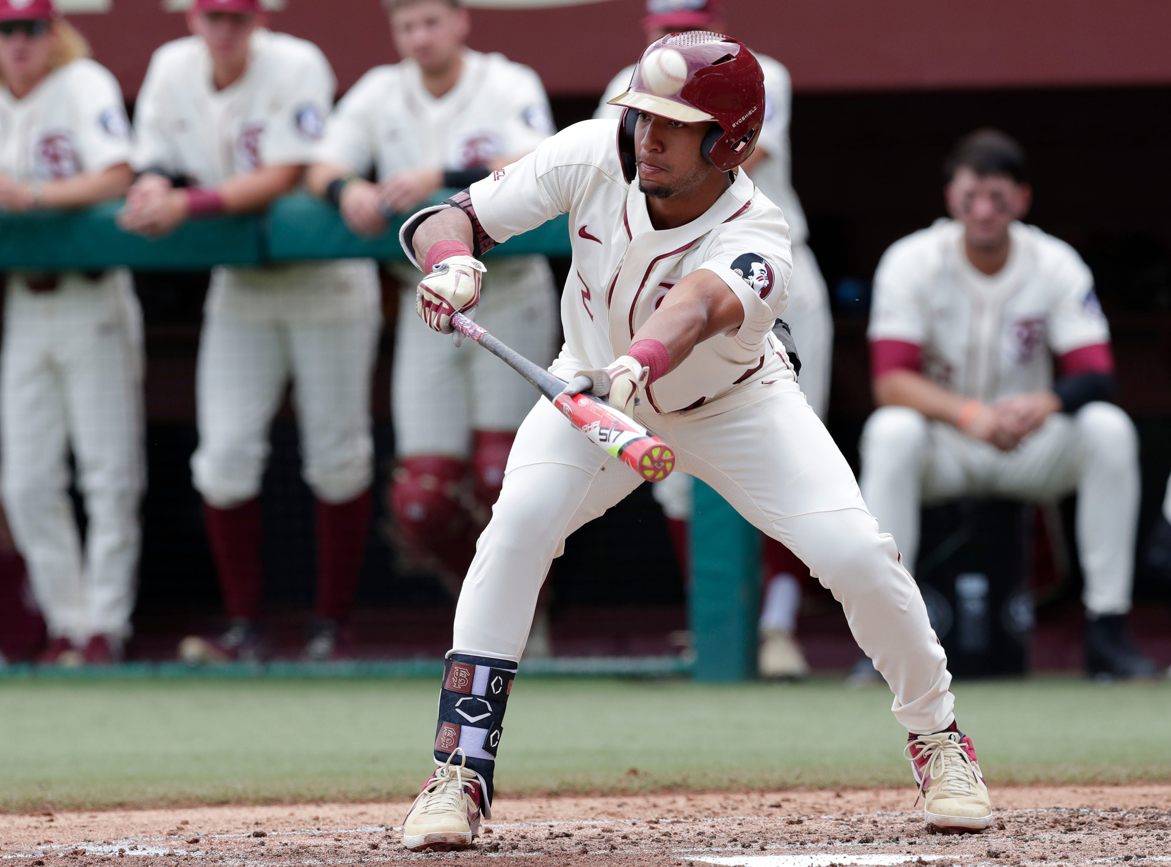 Florida State Seminoles infielder Nander De Sedas (2) tries to bunt the ball but ends up with a foul ball as the Florida State Seminoles host the Maine Black Bears for the second game of the series, Saturday Feb. 16, 2019.
