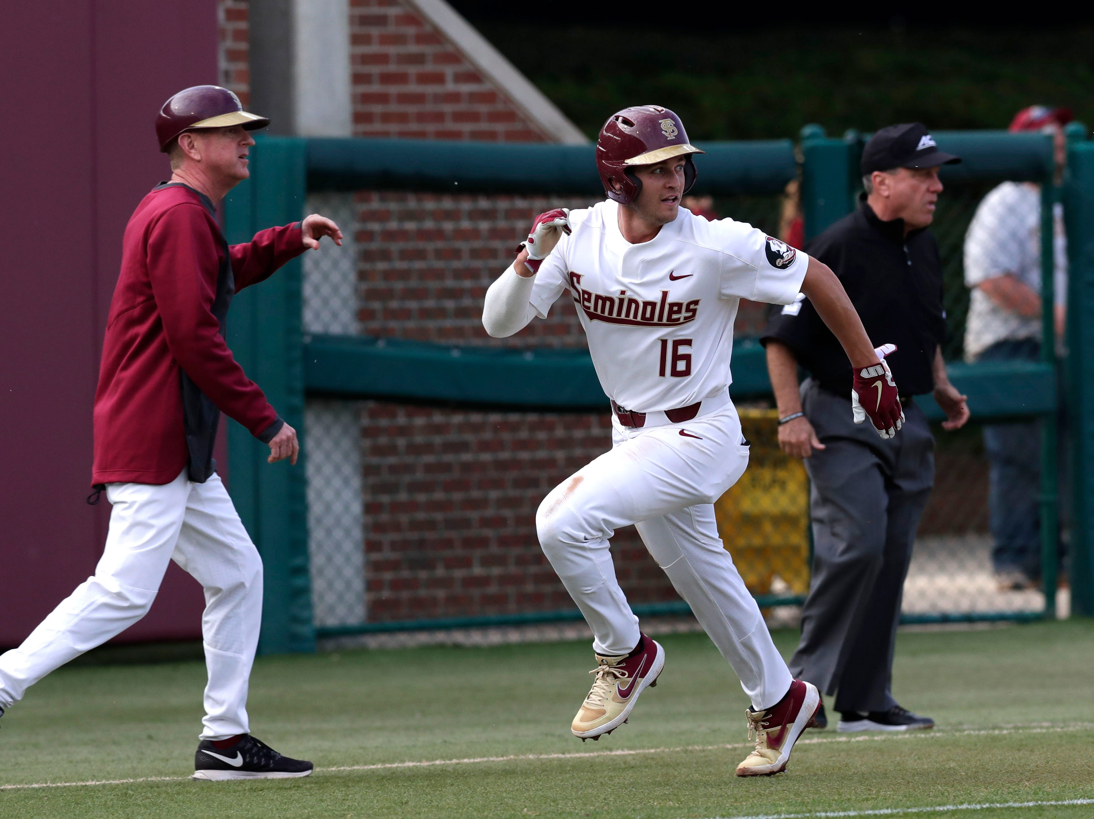 Florida State Seminoles infielder Mike Salvatore (16) runs to home base as the Florida State Seminoles host the Maine Black Bears in the 2019 season opener game, Friday Feb. 15, 2019.