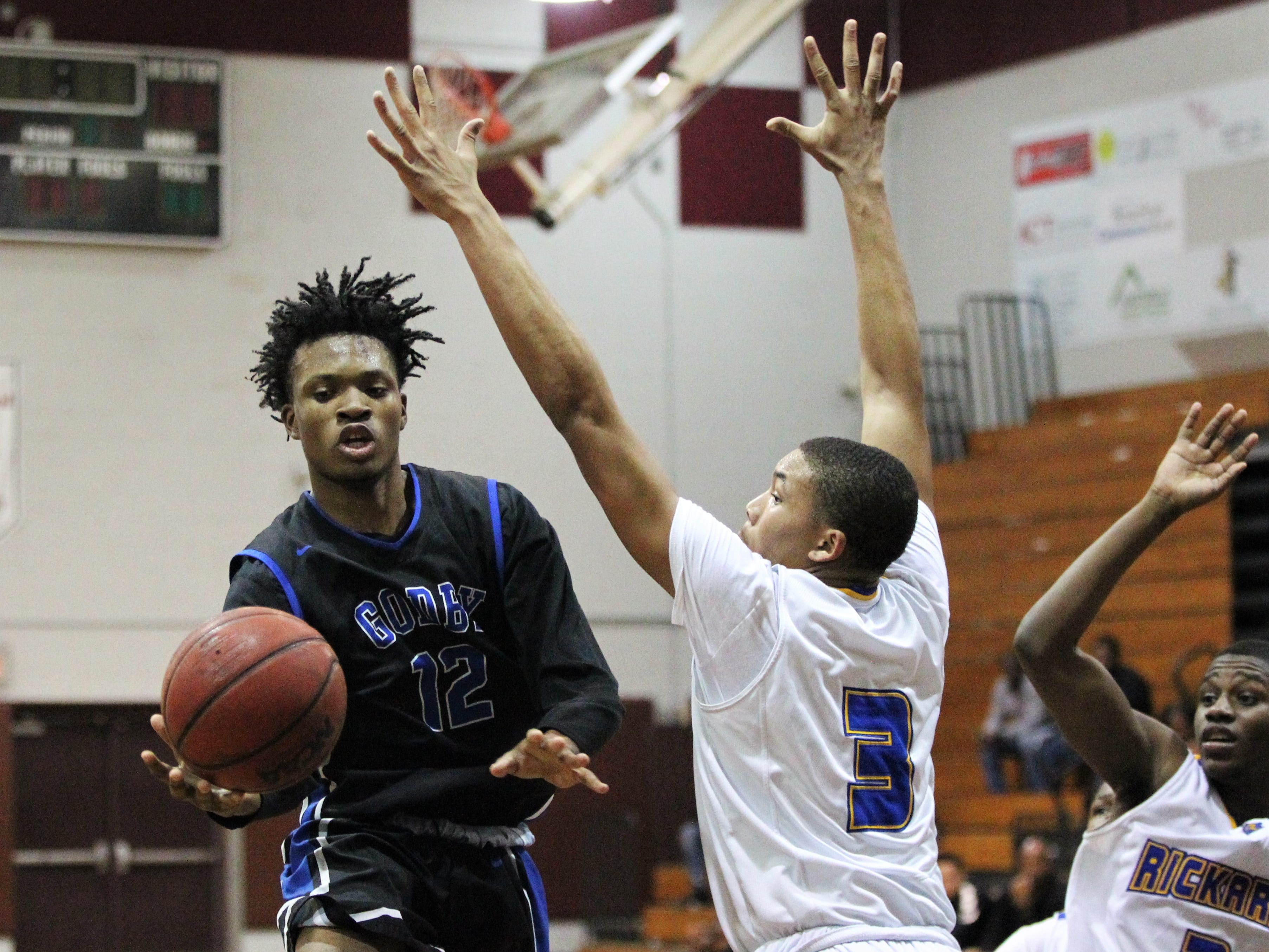 Godby's Steven Lauren tries to get past Rickards' Roddrick Henry as Rickards' boys basketball team beat Godby 58-47 during the District 2-6A championship at Chiles on Feb. 15, 2019.