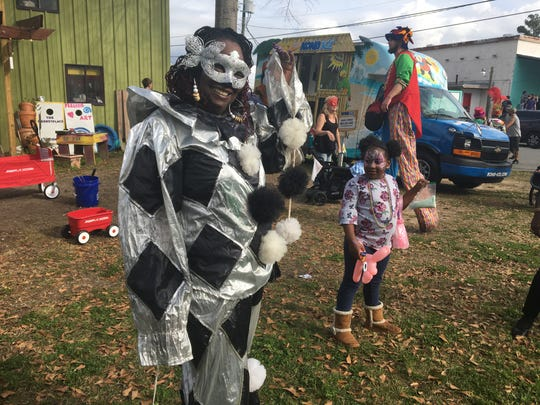 Shirlene Jordan dons a black-and-silver costume and glittery mask at Tallahassee's ArtiGras 2019 festival.