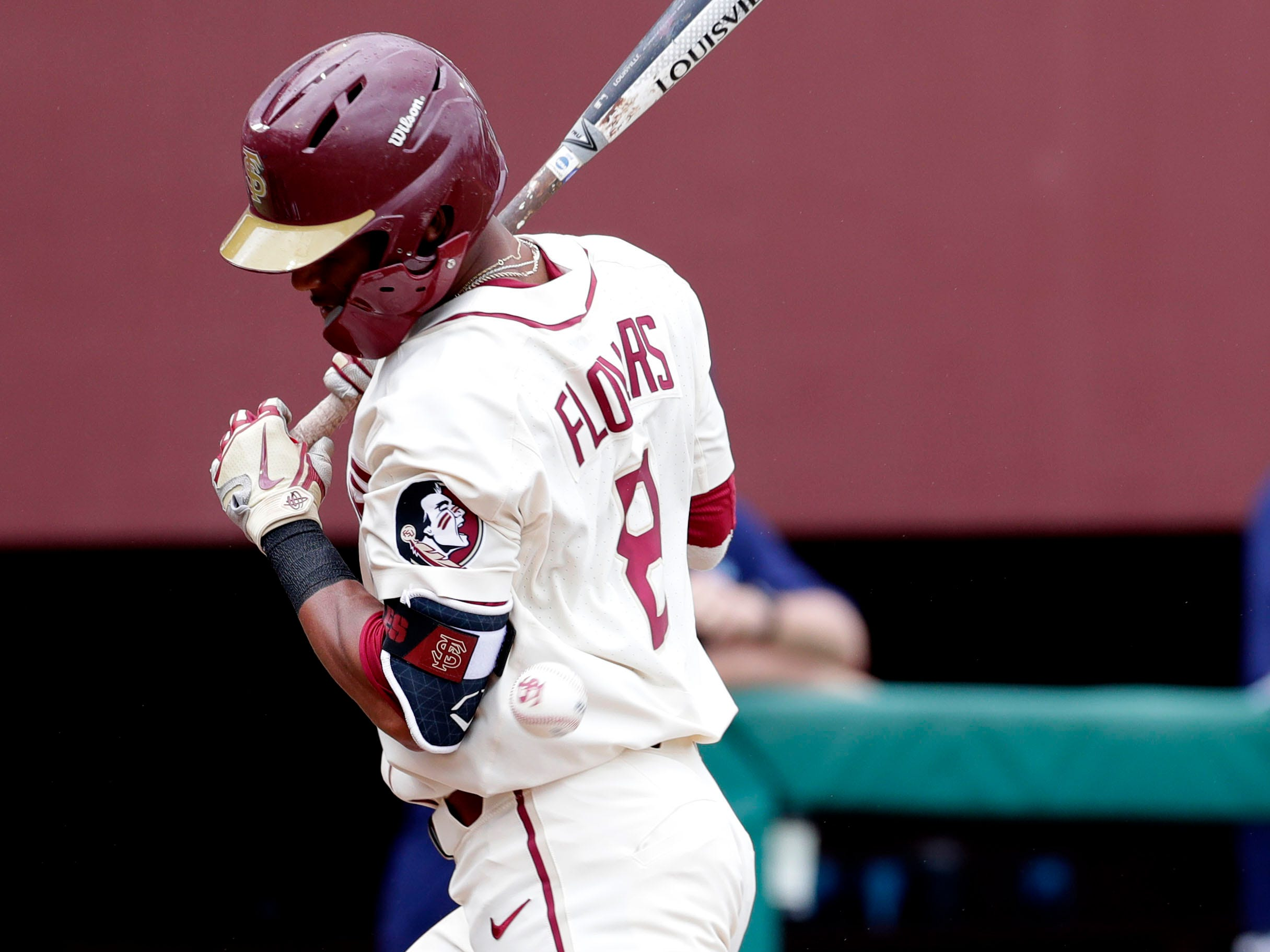 Florida State Seminoles outfielder/right handed pitcher J.C. Flowers (8) gets hit on the arm by the pitch as the Florida State Seminoles host the Maine Black Bears for the second game of the series, Saturday Feb. 16, 2019.