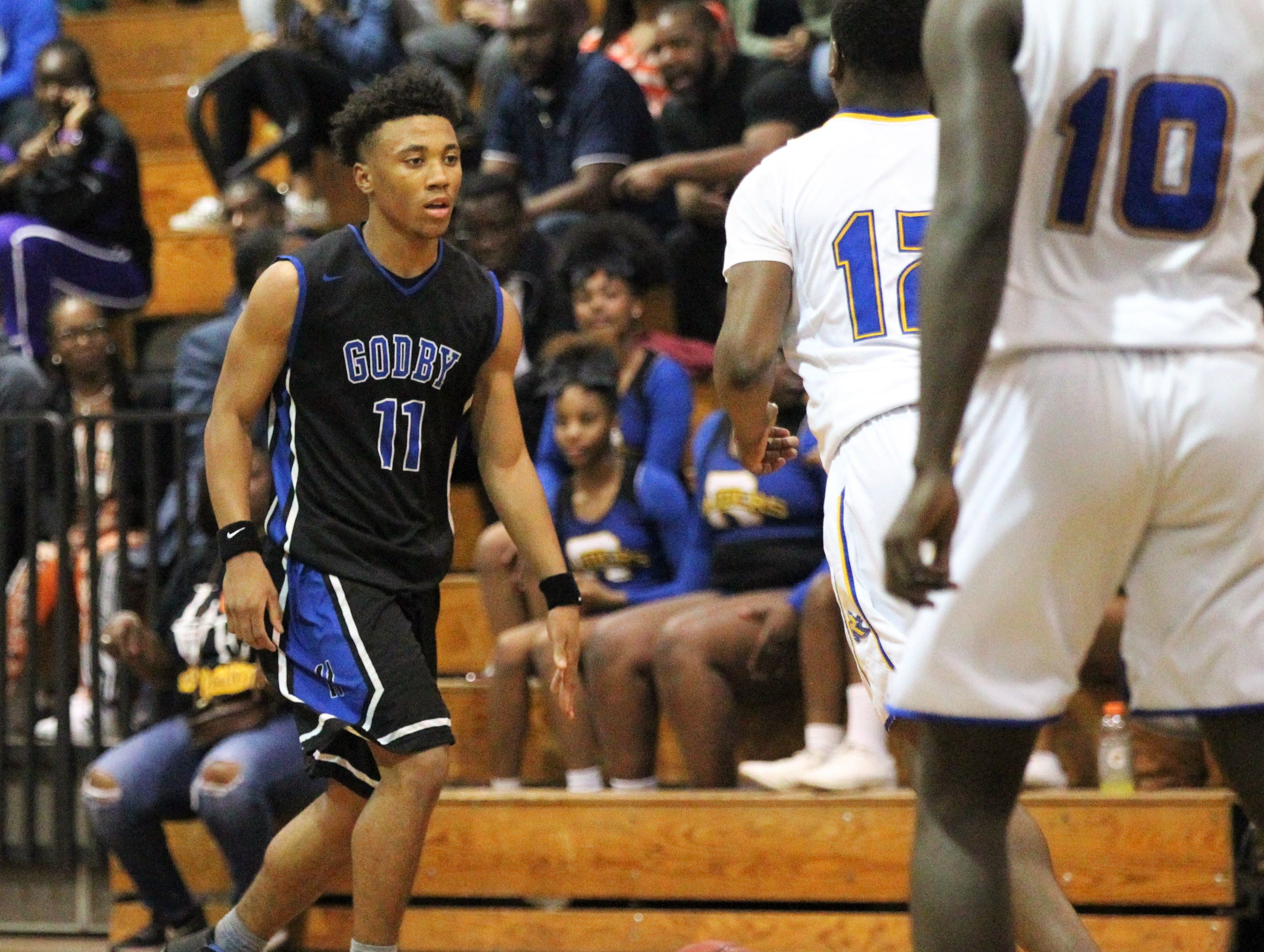 Godby's Jalil Webster brings the ball up the court as Rickards' boys basketball team beat Godby 58-47 during a District 2-6A championship game at Chiles on Feb. 15, 2019.