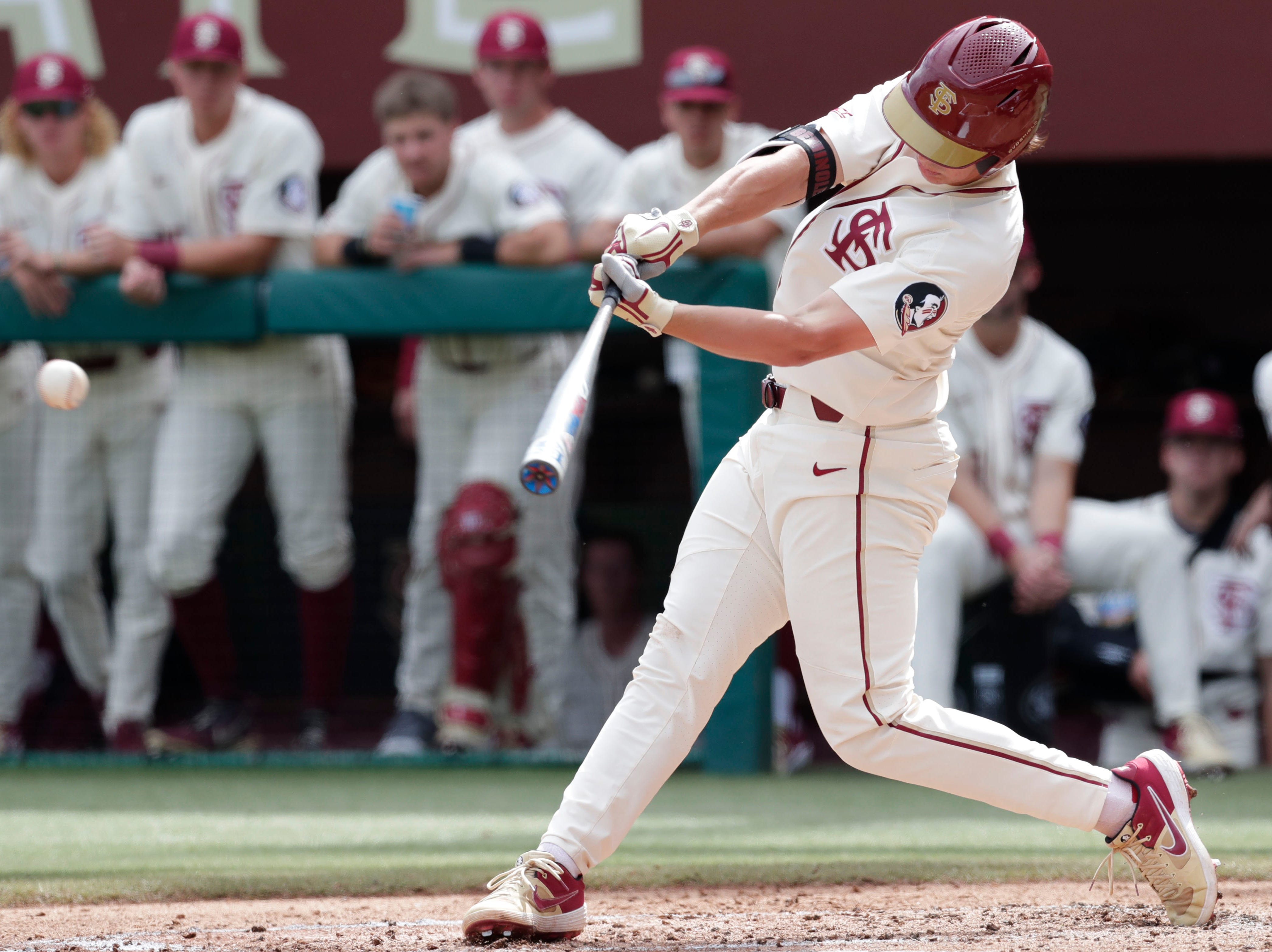 Florida State Seminole infielder Nico Baldor (51) makes contact with the ball as the Florida State Seminoles host the Maine Black Bears for the second game of the series, Saturday Feb. 16, 2019.
