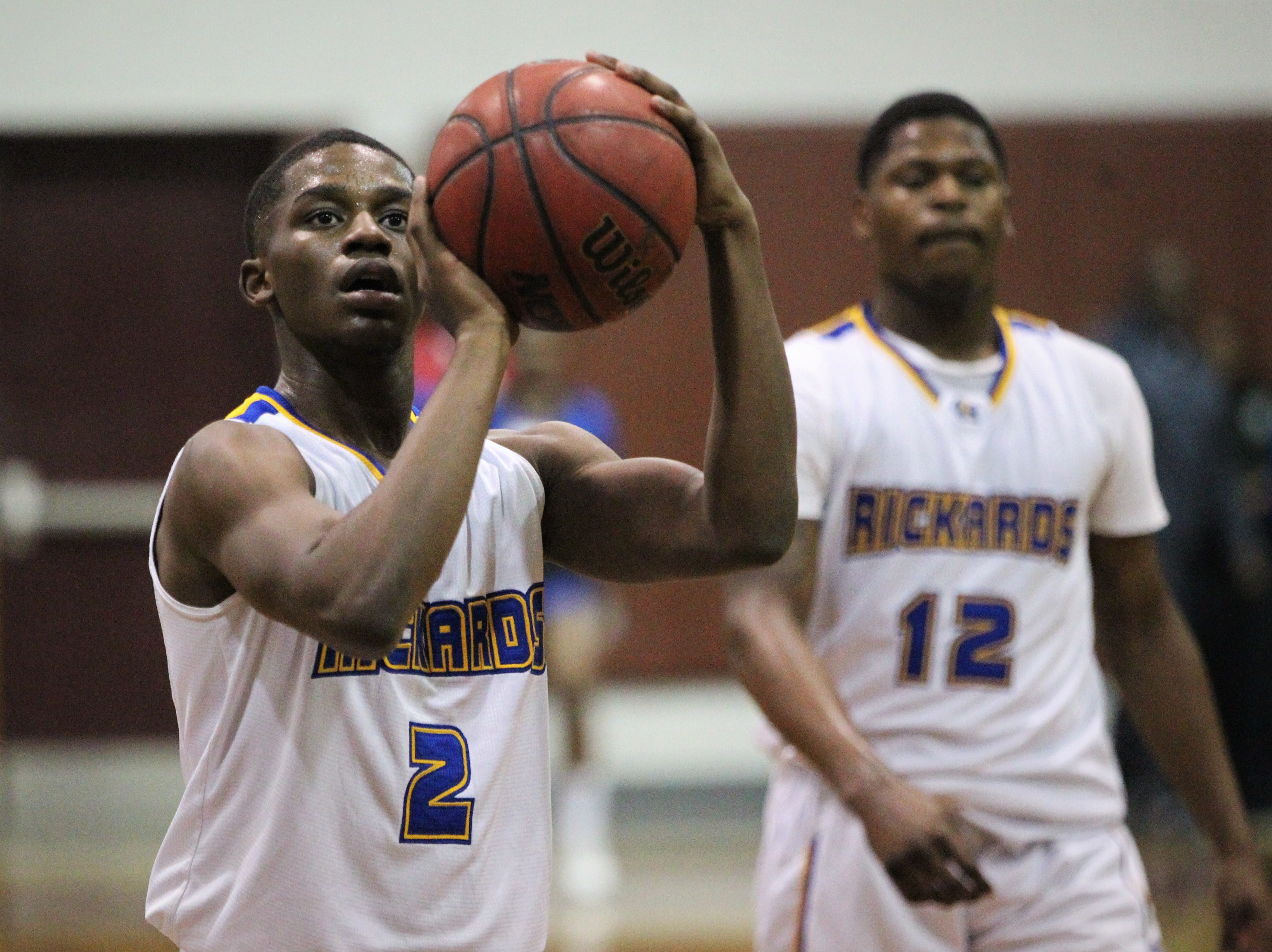 Rickards' Otis Young shoots a free throw as Rickards' boys basketball team beat Godby 58-47 during the District 2-6A championship at Chiles on Feb. 15, 2019.