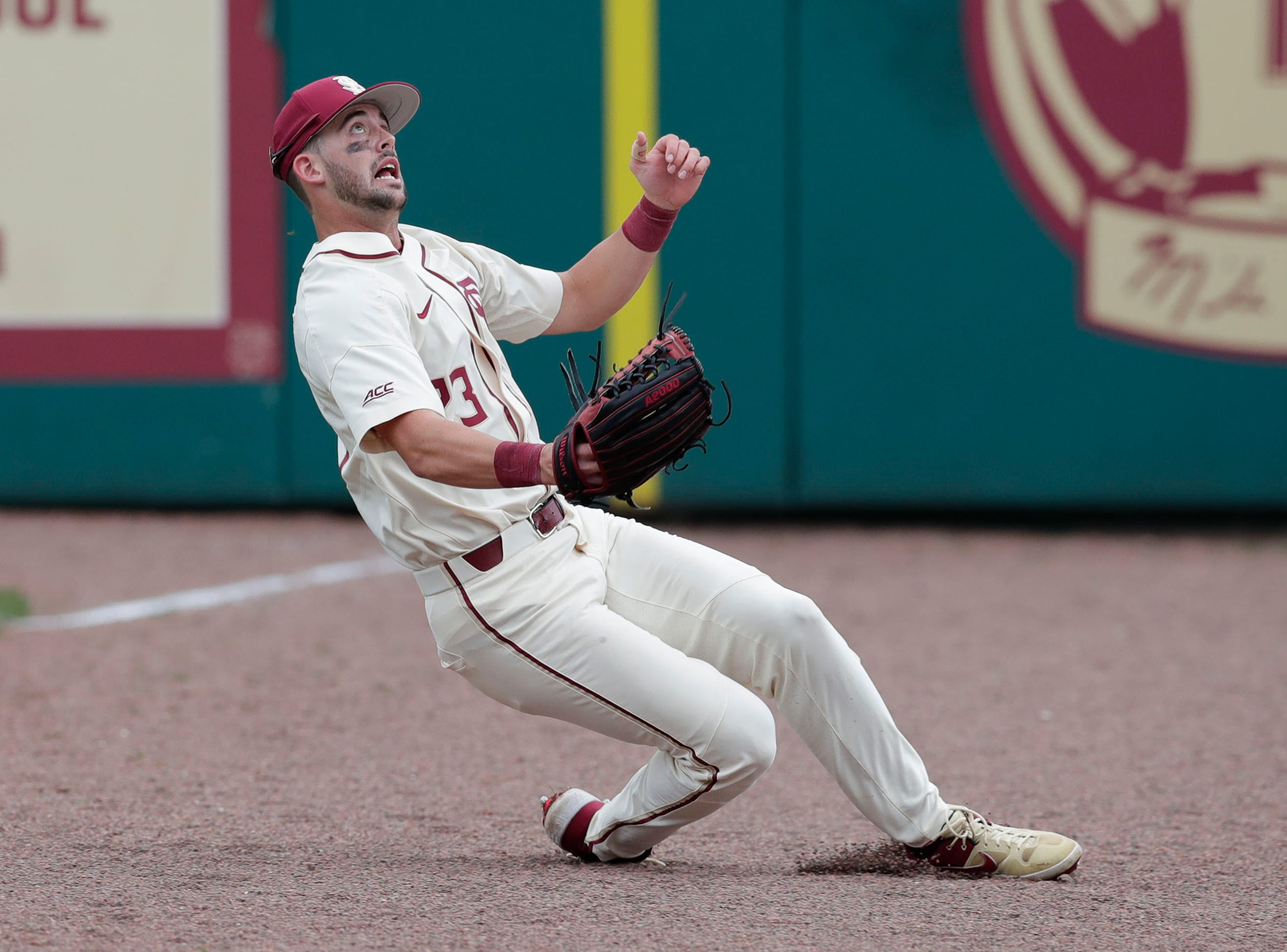 Florida State Seminoles outfielder/left handed pitcher Reese Albert (23) slides as he tries to catch a foul ball. tTe Florida State Seminoles host the Maine Black Bears for the second game of the series, Saturday Feb. 16, 2019.