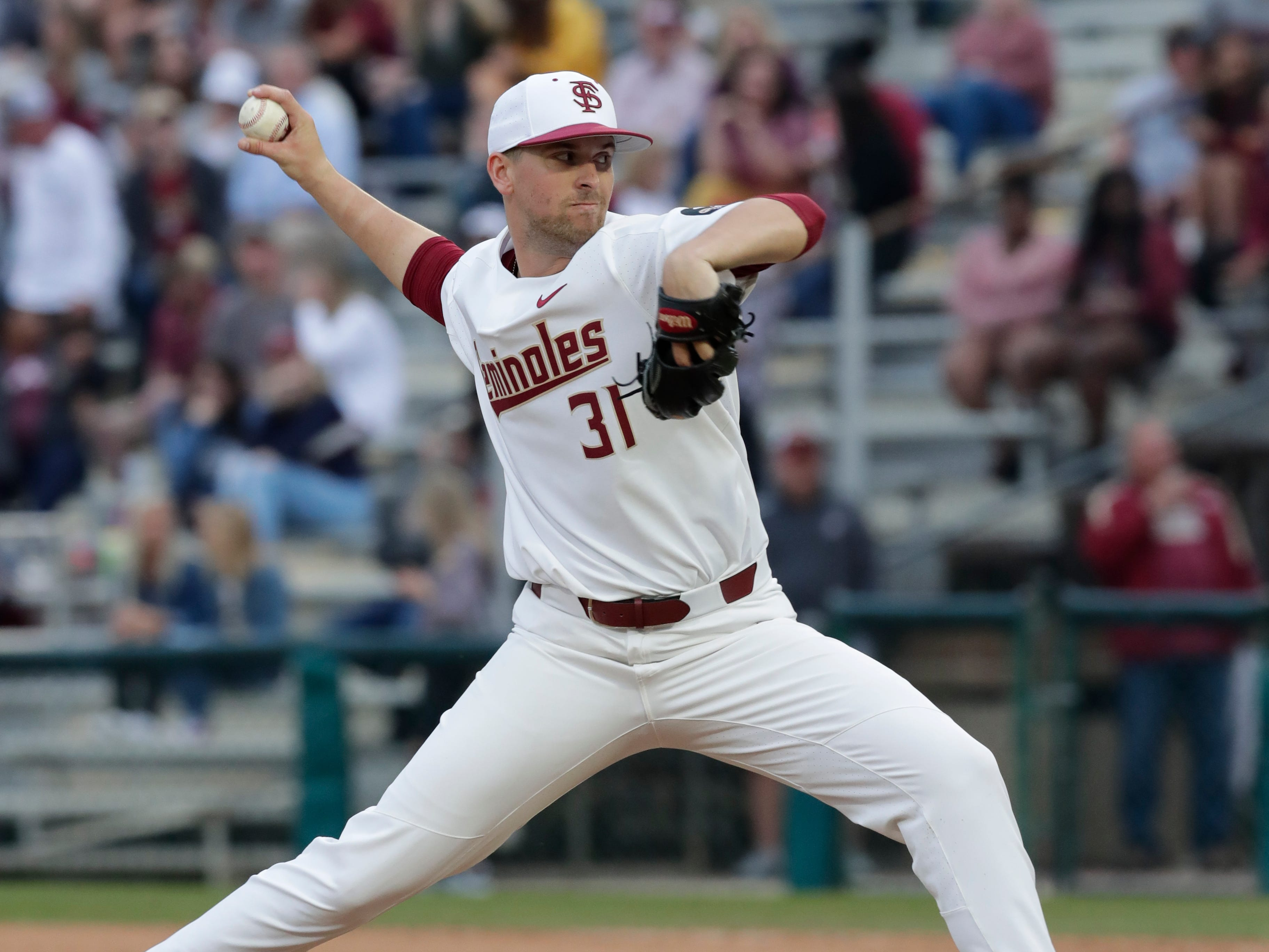 Florida State Seminoles right handed pitcher Conor Grady (31) pitches to the batter as the Florida State Seminoles host the Maine Black Bears in the 2019 season opener game, Friday Feb. 15, 2019.