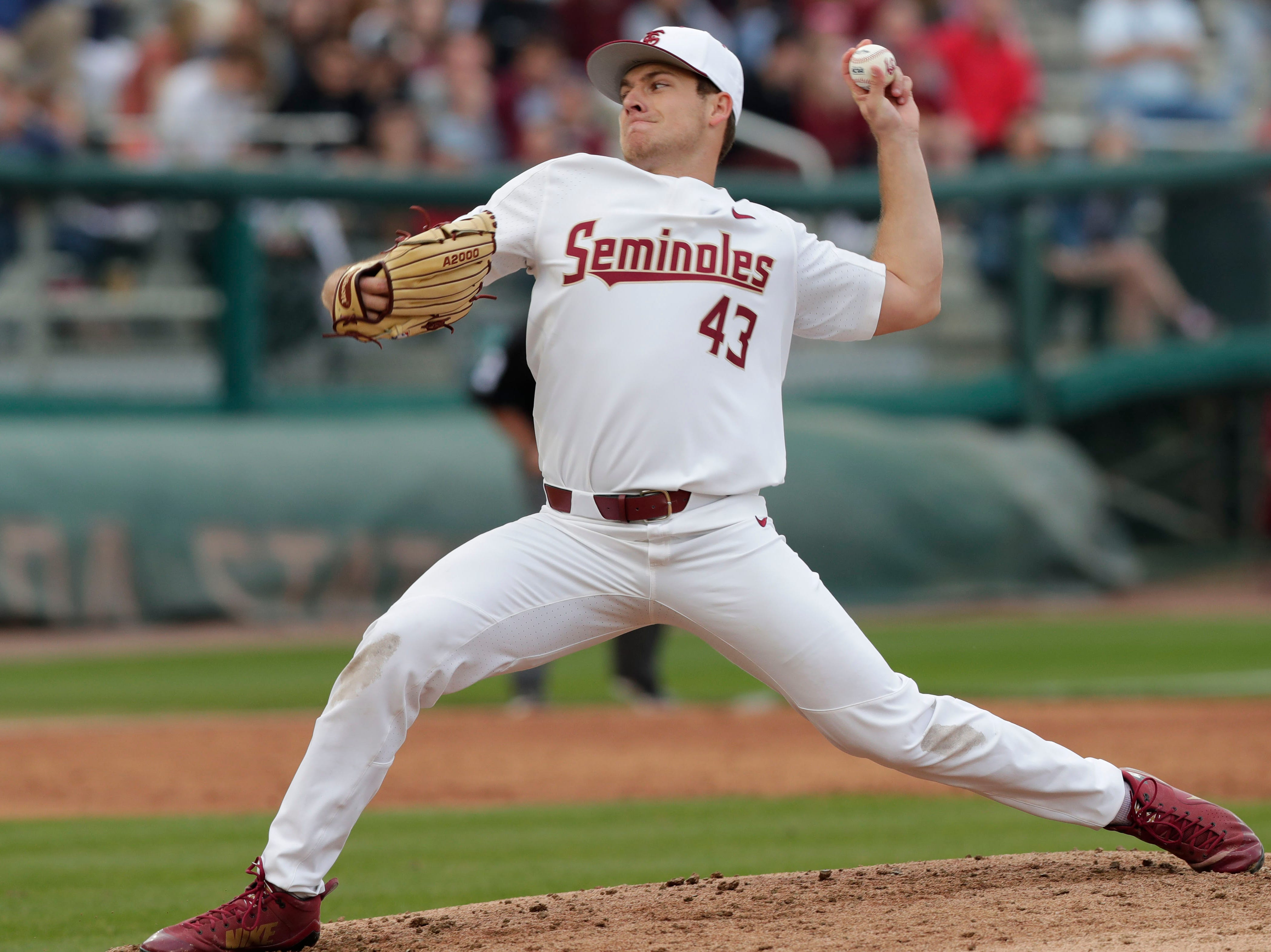 Florida State Seminoles left handed pitcher/Outfielder Drew Parrish (43) as he pitches to the batter. The Florida State Seminoles host the Maine Black Bears in the 2019 season opener game, Friday Feb. 15, 2019.
