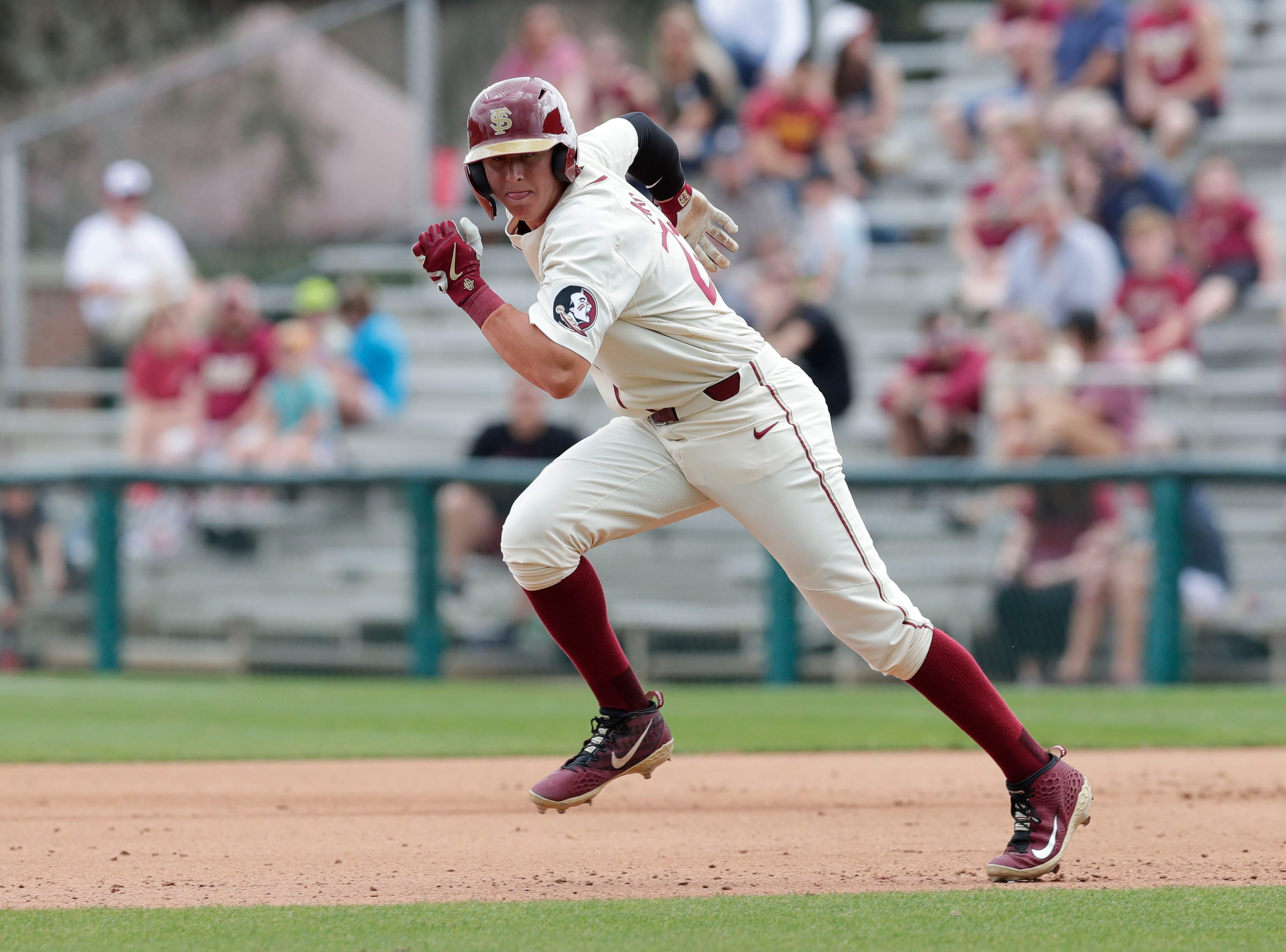 Florida State Seminoles outfielder Robby Martin (26) runs to second as the Florida State Seminoles host the Maine Black Bears for the second game of the series, Saturday Feb. 16, 2019.