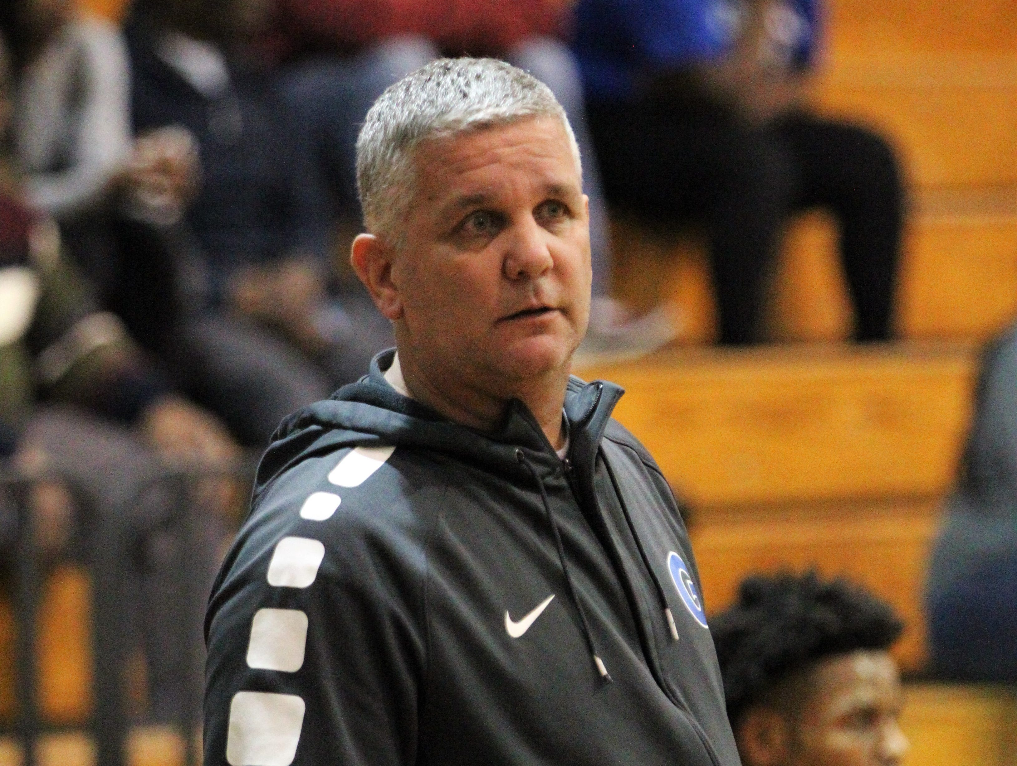 Godby boys basketball coach Andy Colville watches his team as Rickards beat Godby 58-47 during the District 2-6A championship at Chiles on Feb. 15, 2019.