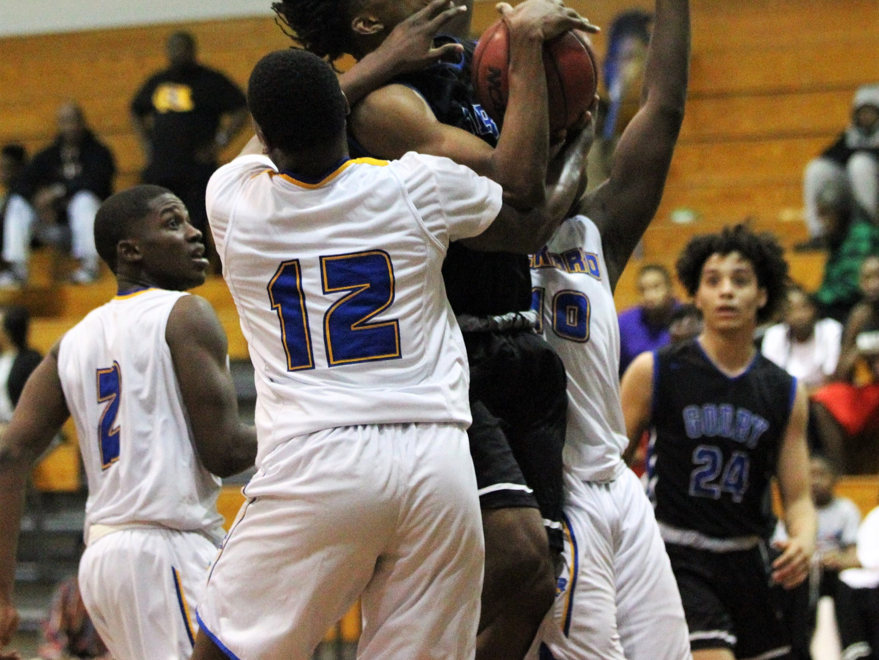 Godby's Steve Laurent is fouled on a drive as Rickards' boys basketball team beat Godby 58-47 during a District 2-6A championship game at Chiles on Feb. 15, 2019.