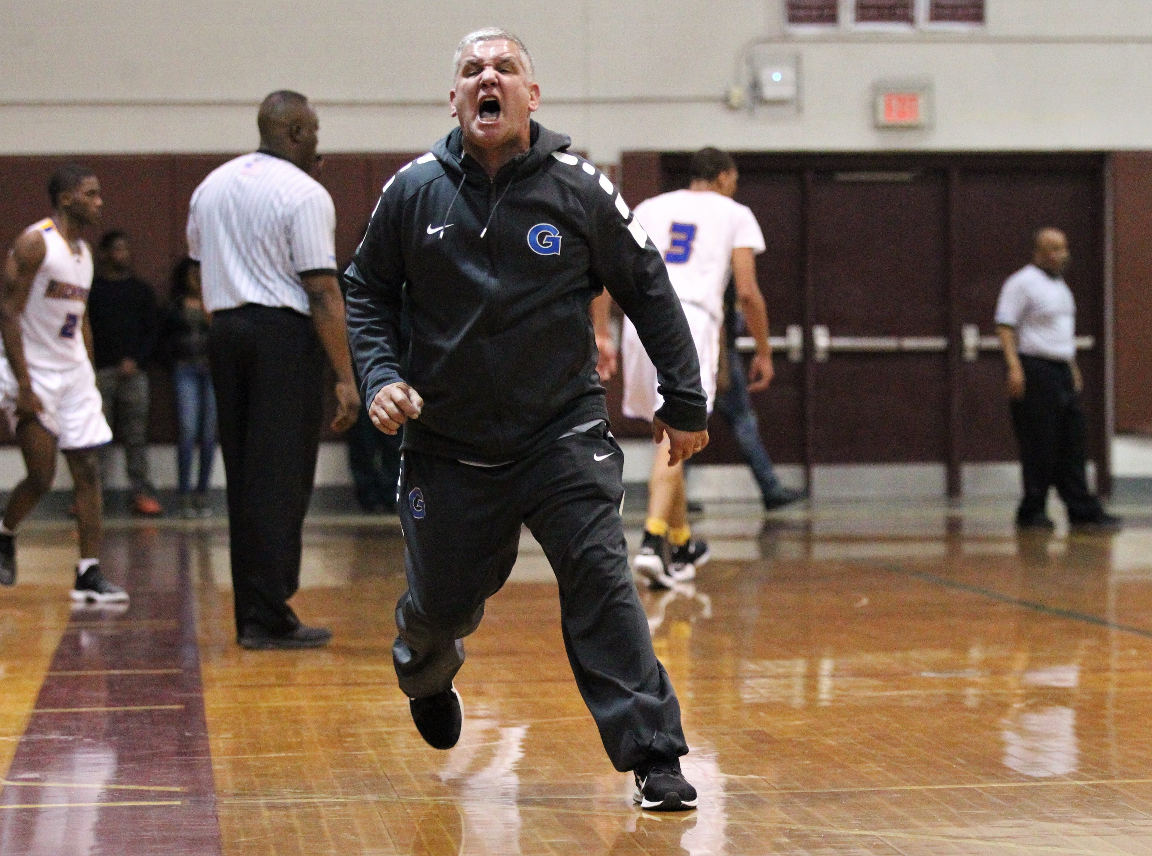 Godby boys basketball coach Andy Colville stomps on the floor over a non-call as Rickards beat Godby 58-47 during a District 2-6A championship game at Chiles on Feb. 15, 2019.