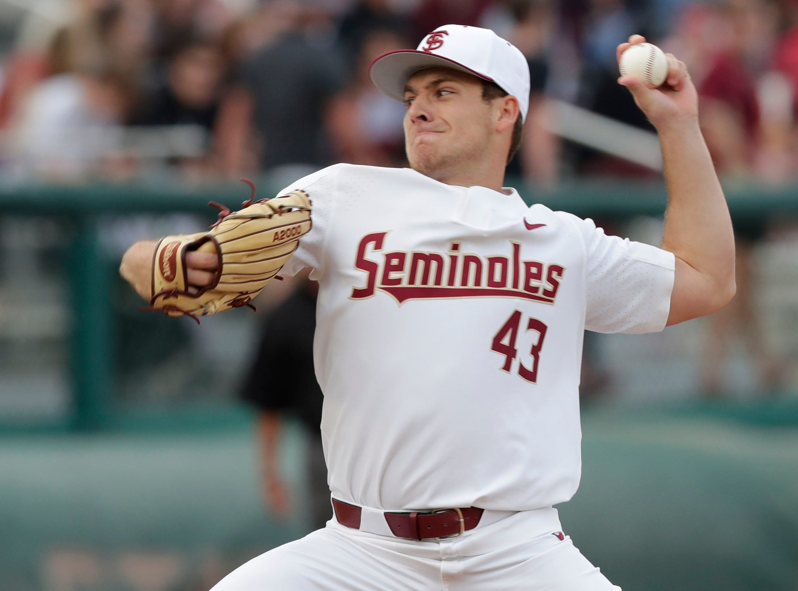 Florida State Seminoles left handed pitcher/Outfielder Drew Parrish (43) throws a pitch as the Florida State Seminoles host the Maine Black Bears in the 2019 season opener game, Friday Feb. 15, 2019.
