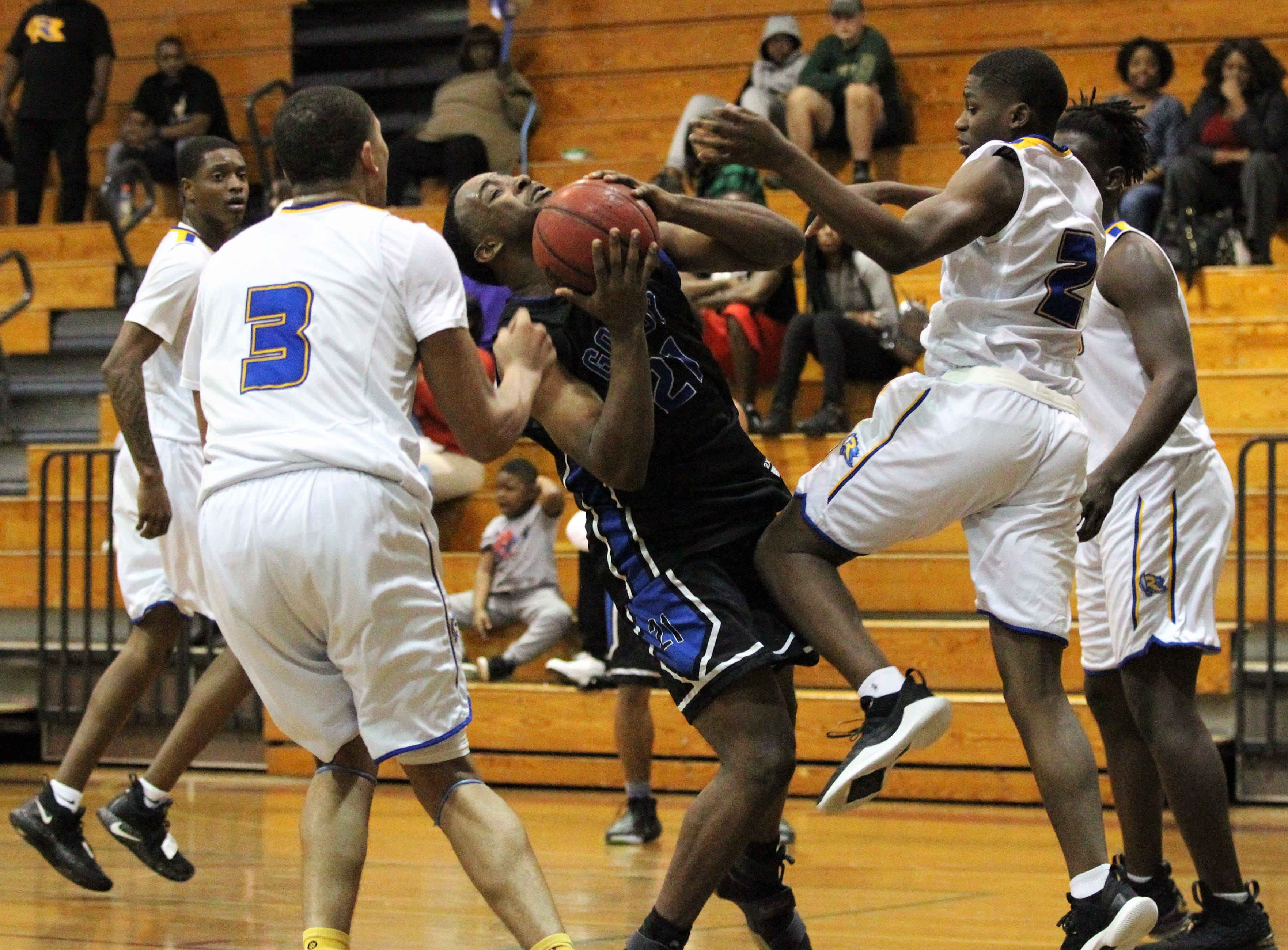 Godby's Kenneth Parker goes up for a layup amid contact as Rickards' boys basketball team beat Godby 58-47 during a District 2-6A championship game at Chiles on Feb. 15, 2019.